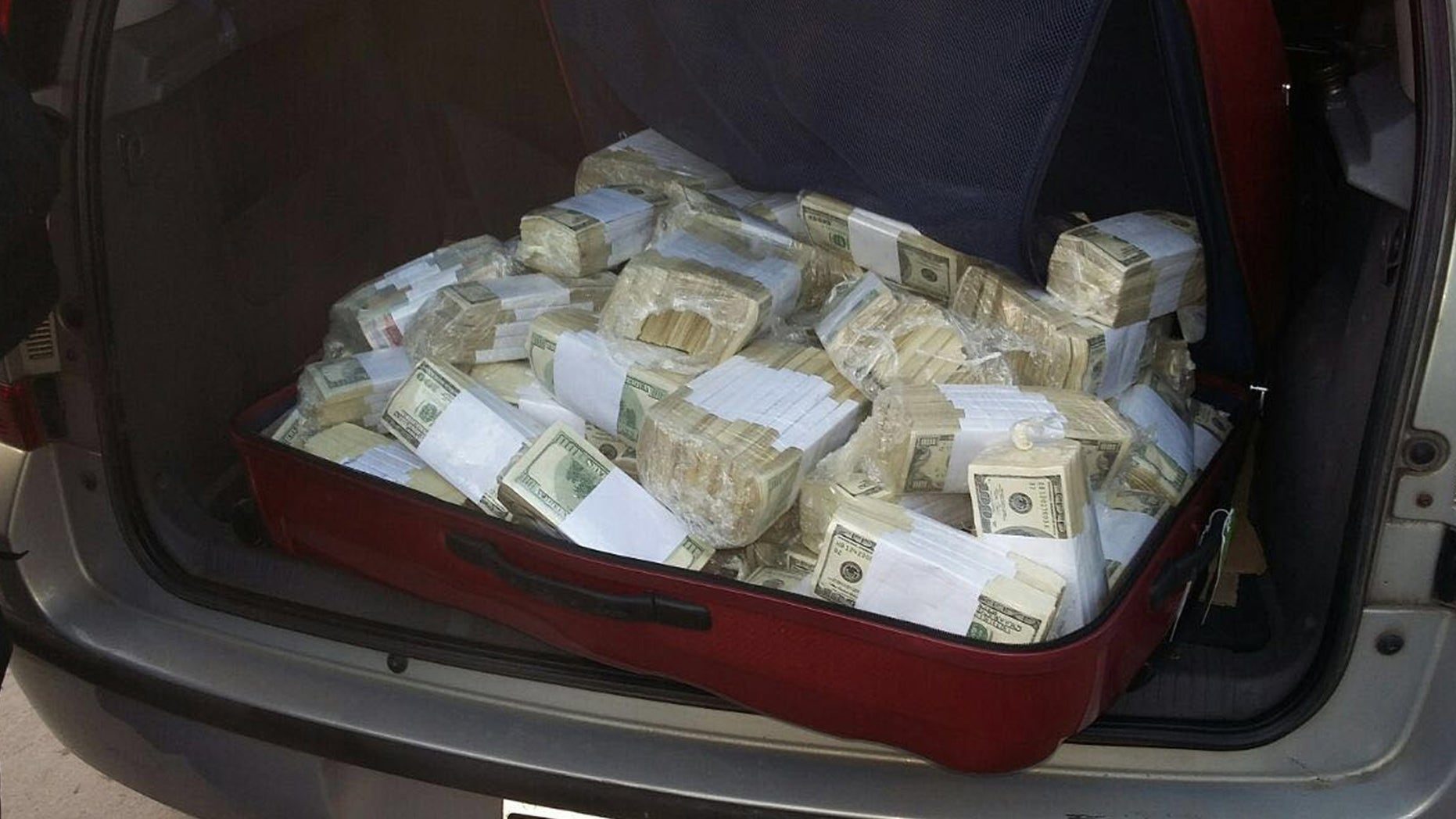 BEST QUALITY AVAILABLE - In this photo released by the Buenos Aires Province Security Ministry, wads of cash sit in the back of a vehicle shortly after former Public Works Secretary Jose Lopez was caught by police hiding millions at a monastery in the outskirts of Buenos Aires, Argentina, Tuesday, June 14, 2016. Lopez, an official in the government of former President Cristina Fernandez was arrested while trying to hide millions in cash and jewels. (Buenos Aires Province Security Ministry via AP)