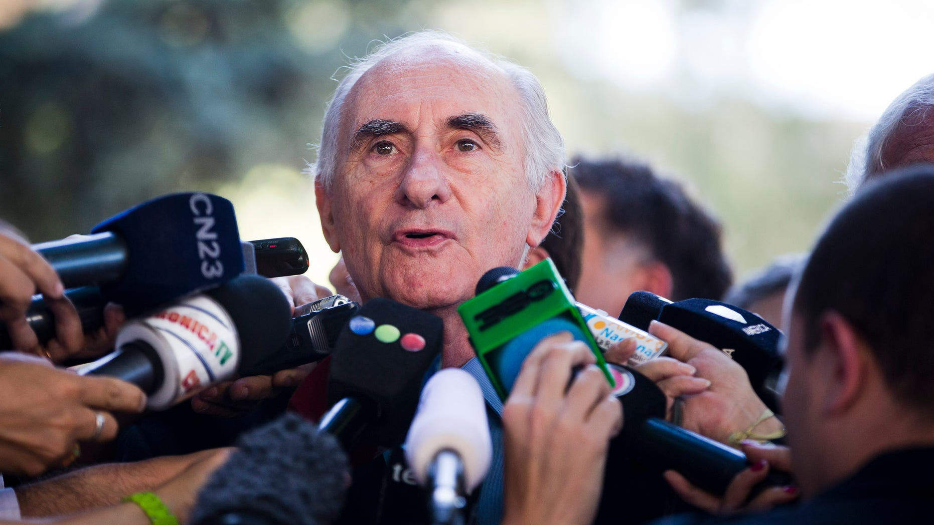 Former Argentine President Fernando de la Rua speaks to the media Monday, Dec. 23, 2013.