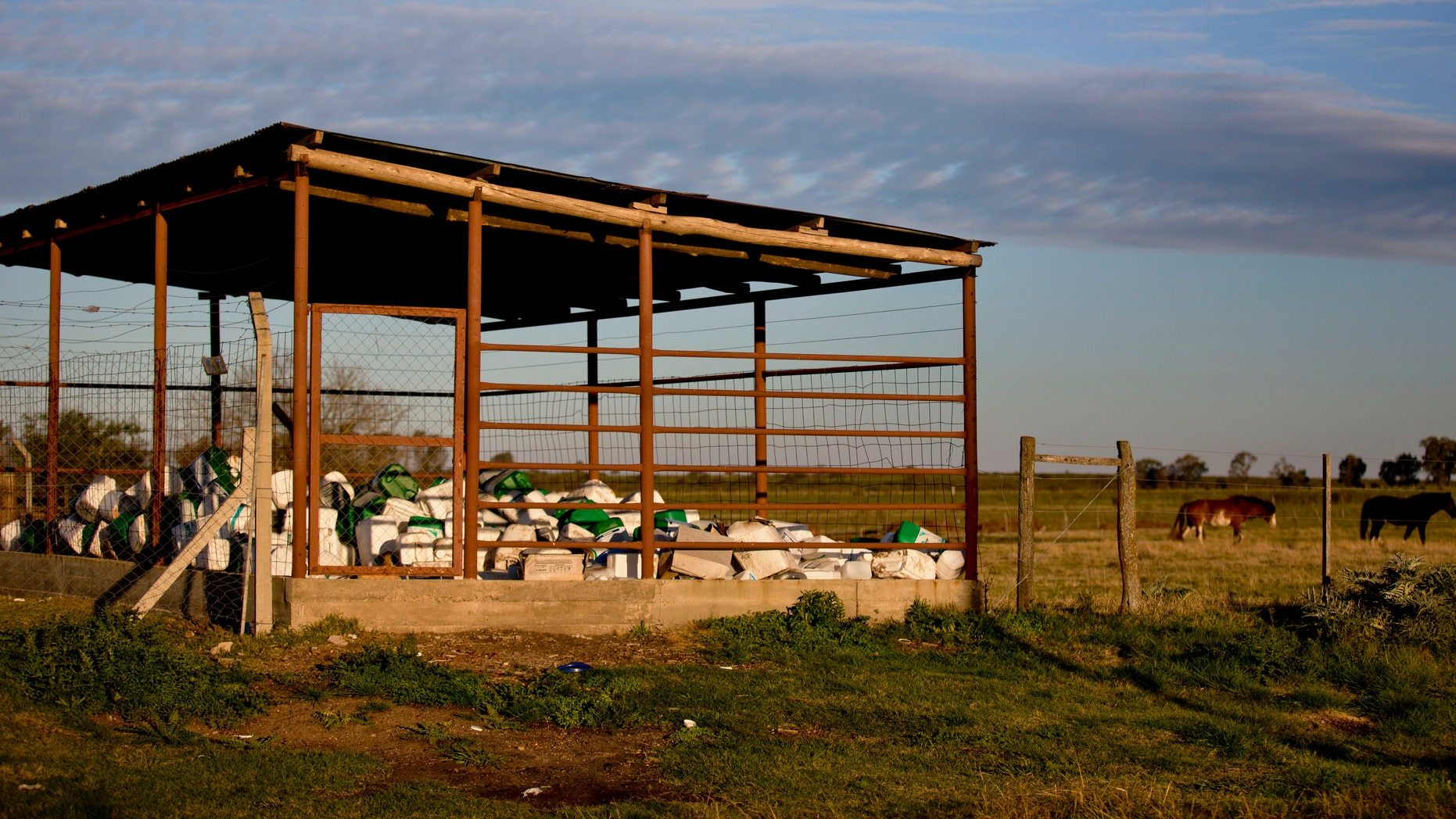 Empty pesticide containers ready for recycling are collected inside an enclosure by the farming business association in Gualeguaychu, in Entre Rios province, Argentina. (AP Photo/Natacha Pisarenko)