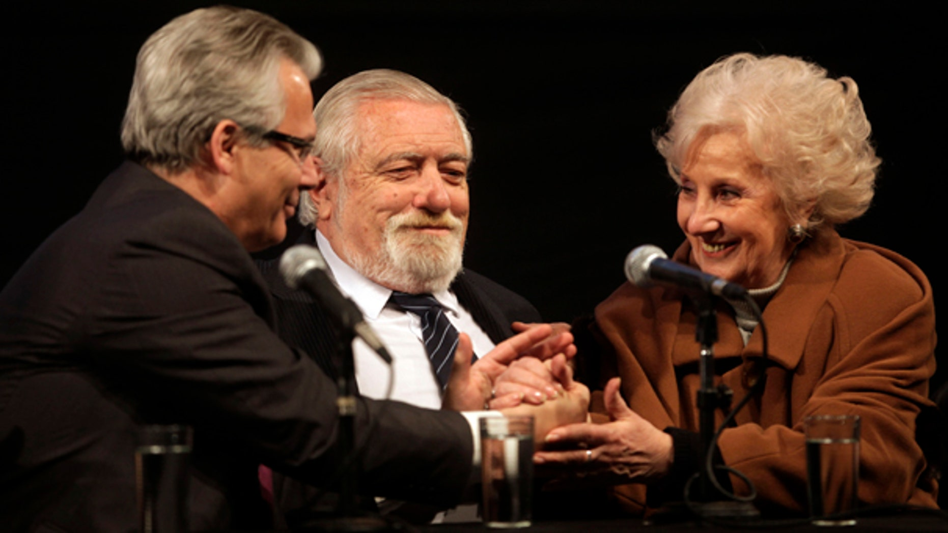 July 15: Spain's Judge Baltazar Garzon, holds hands with Estela de Carlotto, president of the Grandmother's of Plaza de Mayo organization during a ceremony in support of Garzon, at the former Argentine Navy School of Mechanics (ESMA) in Buenos Aires. (AP)