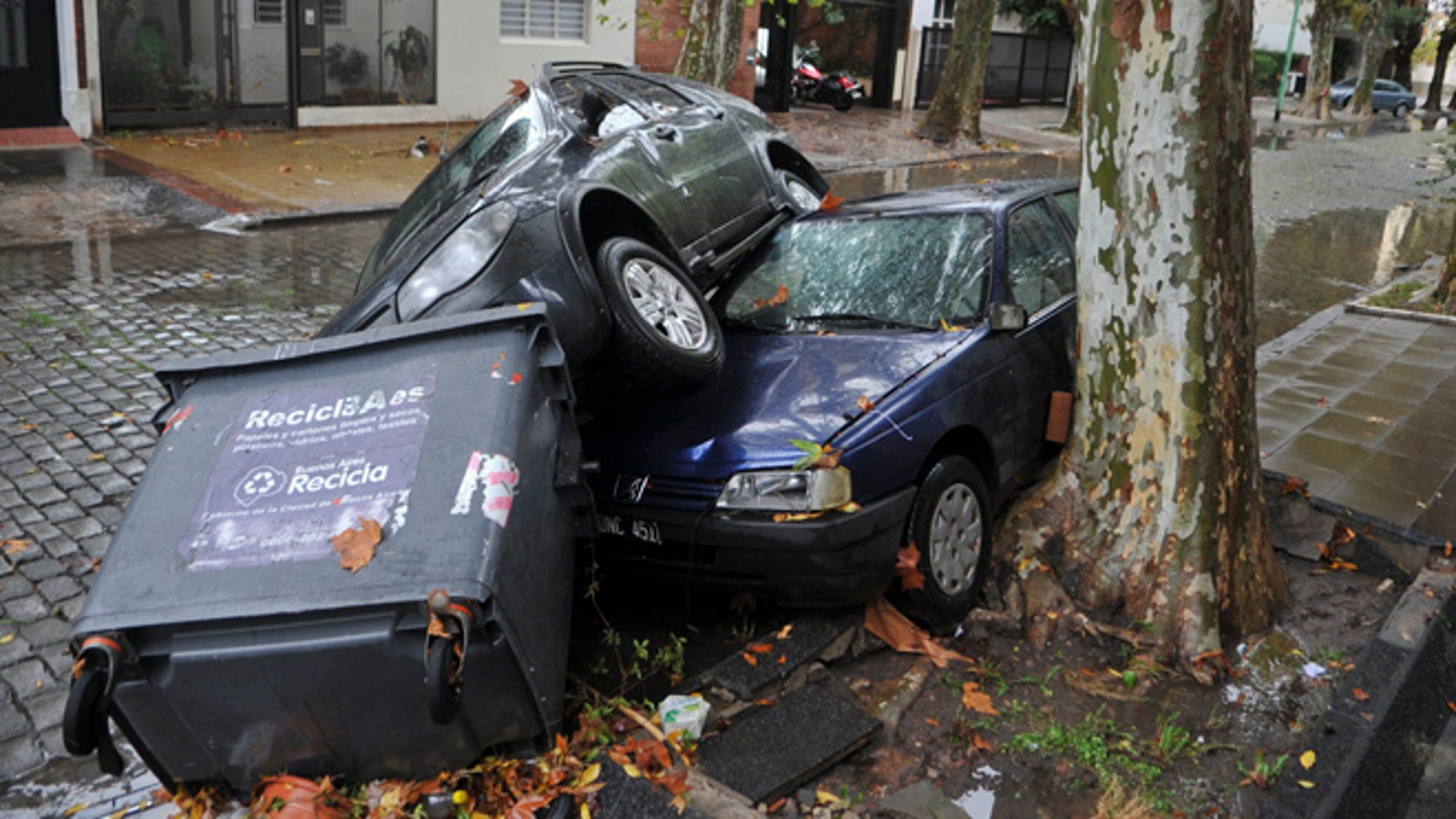 April 2, 2013: Cars and garbage containers lay piled up after flash flooding caused damage overnight in Buenos Aires, Argentina. According to city officials, at least five people were killed during the heavy rains.