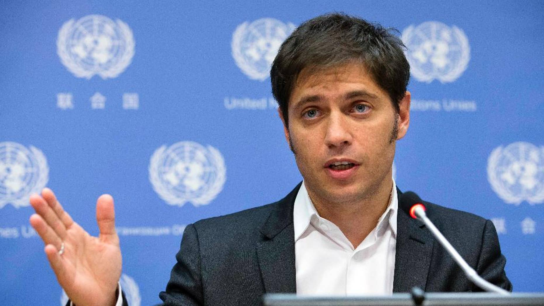 Argentine Economic Minister Axel Kicillof speaks during a news conference at United Nations headquarters, Wednesday, June 25, 2014. The winners of a decade-long debt battle asked a U.S. judge on Tuesday to deny Argentina's request for more negotiating time to avoid a catastrophic default. (AP Photo/John Minchillo)
