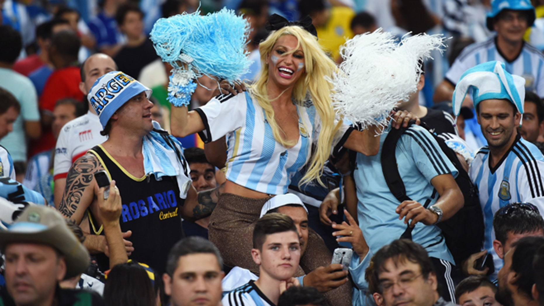 RIO DE JANEIRO, BRAZIL - JUNE 15:  An Argentina fan cheers in the crowd prior to the 2014 FIFA World Cup Brazil Group F match between Argentina and Bosnia-Herzegovina at Maracana on June 15, 2014 in Rio de Janeiro, Brazil.  (Photo by Matthias Hangst/Getty Images)