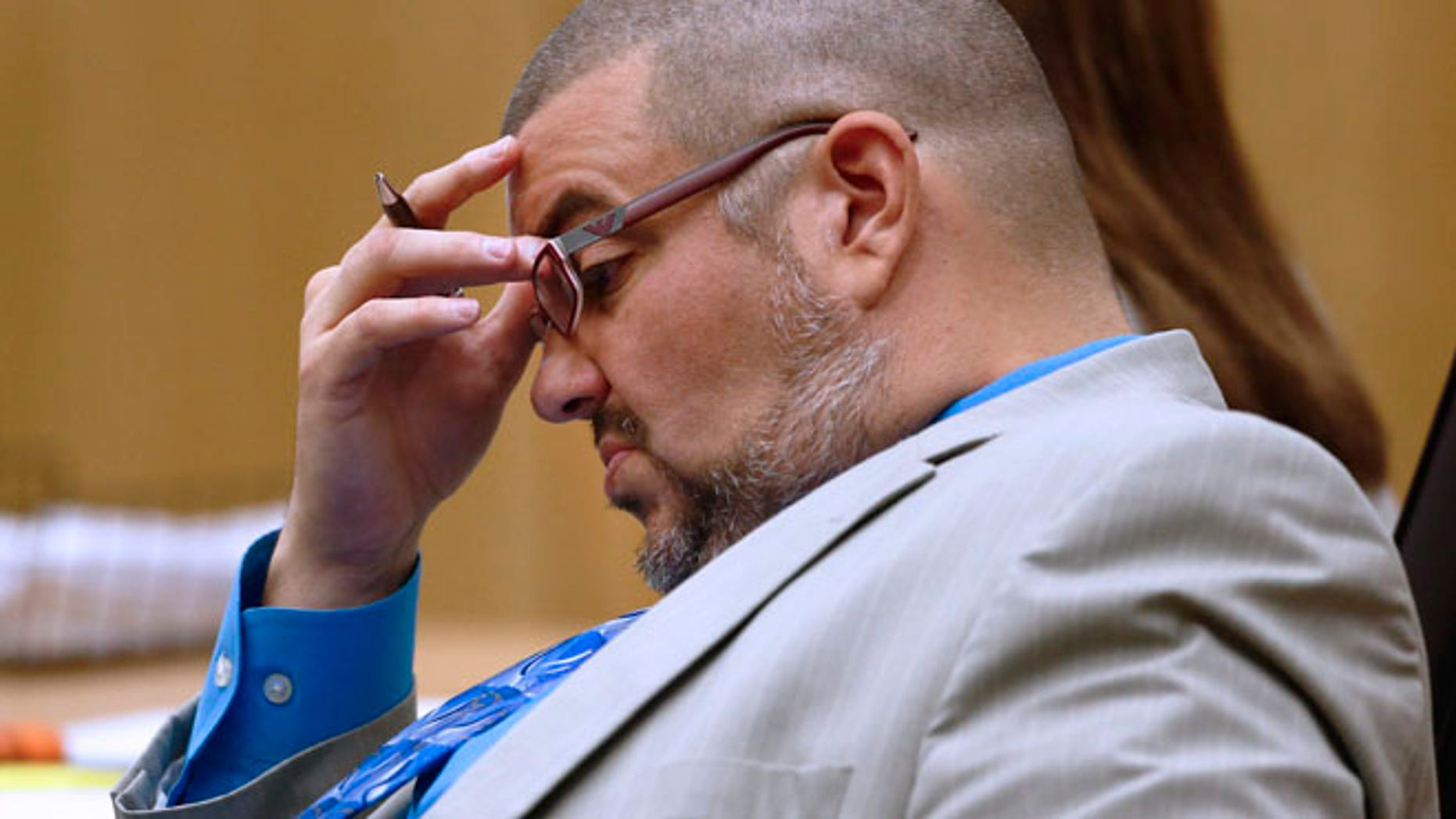 Kirk Nurmi, photographed, and Jennifer Willmott asked a judge for permission to withdraw from the Jodi Arias case.