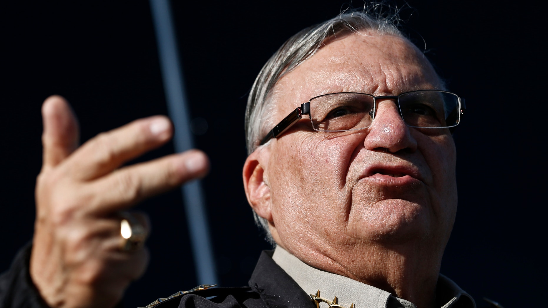 FILE - In this Jan. 9, 2013 file photo, Maricopa County Sheriff Joe Arpaio speaks with the media in Phoenix. Arpaio begins a four-day hearing Tuesday, April 21,  that could bring him fines, damage his credibility and make him politically vulnerable for his acknowledged violations of a judge's orders in a racial profiling case. (AP Photo/Ross D. Franklin,File)