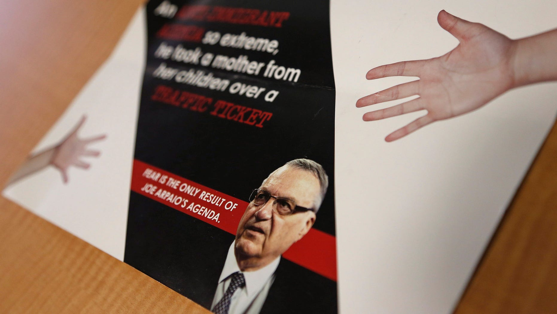 FILE - In this Sept. 13, 2016, file photo, a group backed by the New York hedge fund billionaire George Soros, a longtime bankroller of liberal political causes, is mailing anti-Joe Arpaio fliers to Phoenix-area voters. Paul Penzone, a former Phoenix police sergeant running against Arpaio, is getting a boost from the unlikely Soros source. The sheriff of metro Phoenix has won re-election by crafting an image as a law enforcer who targeted parents who skip out on child support, abusers of animals and immigrants who are in the country illegally. Now, Sheriff Joe Arpaio is the one being targeted in a criminal case after he was charged two weeks before Election Day with contempt-of-court for defying a judge's order in a racial profiling case. (AP Photo/Ross D. Franklin, File)