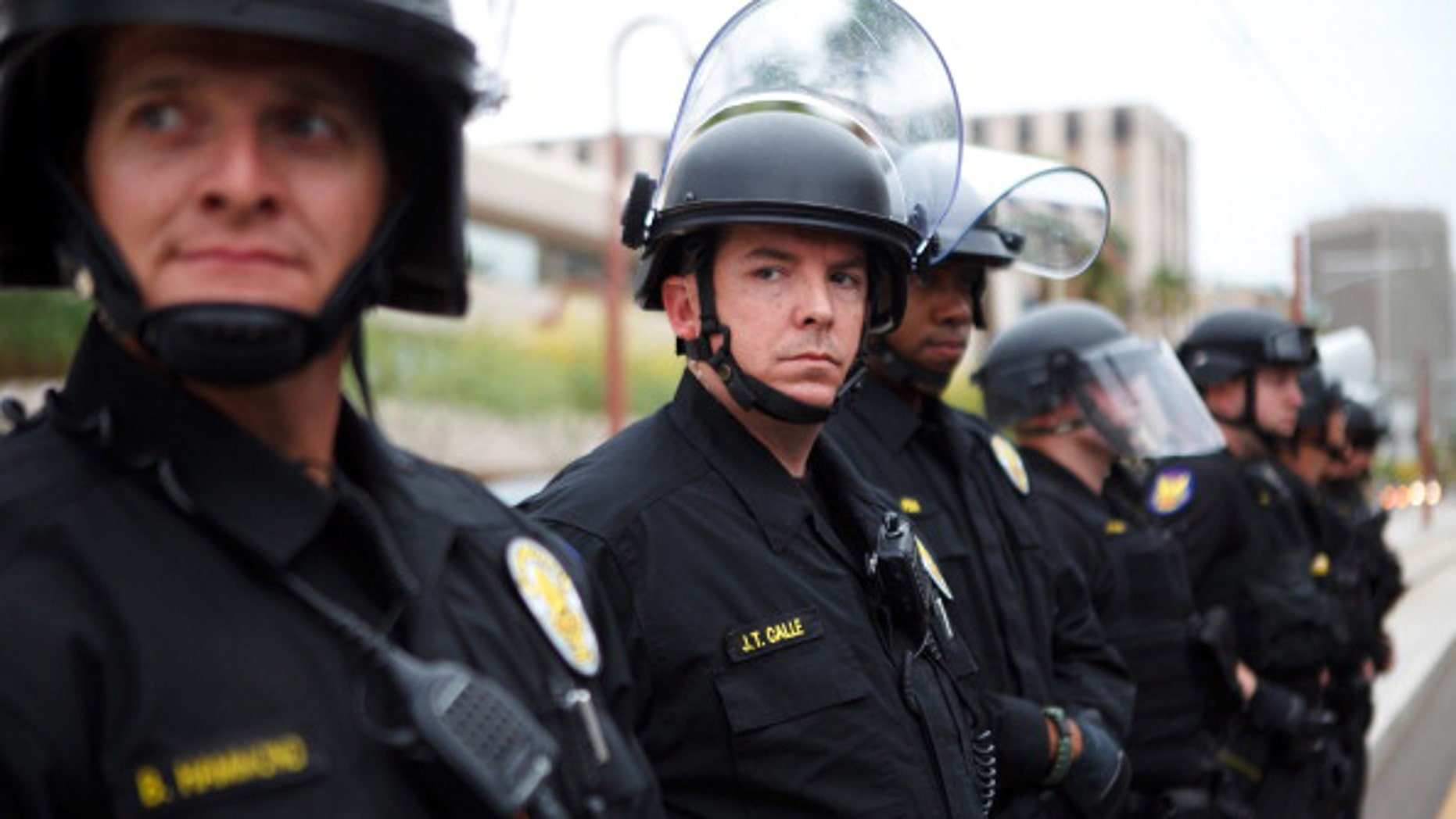 PHOENIX, AZ - APRIL 25:  Police officers look on as protester opposed to Arizona's Immigration Law SB 1070 rally April 25, 2012 in Phoenix, Arizona. Immigrant rights advocates held a day of protest in Phoenix, the same day the U.S. Supreme Court heard arguments over Arizona's 2010 immigration enforcement law. (Photo by Jonathan Gibby/Getty Images)