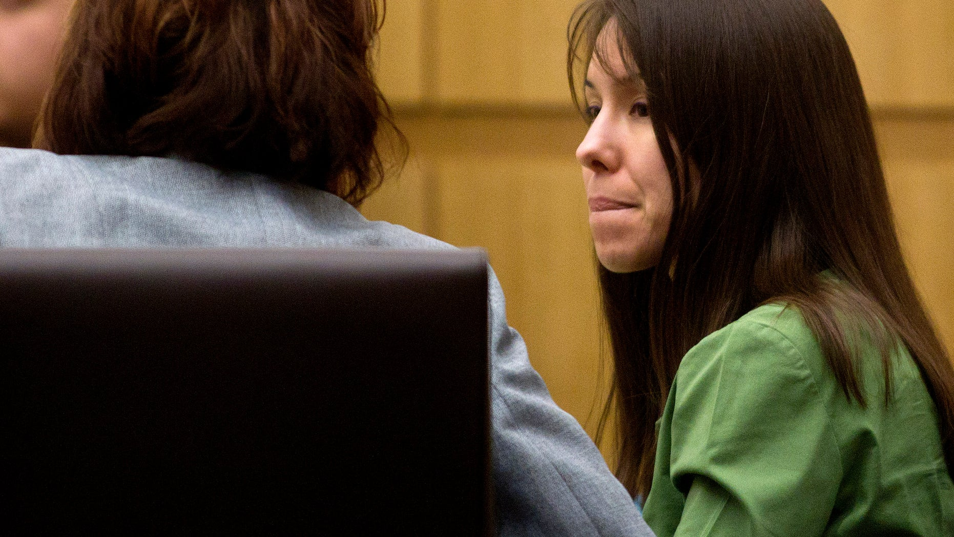 Jan 3, 2012: Defendant Jodi Arias talks with her defense team during her trial at Maricopa County Court in Phoenix.