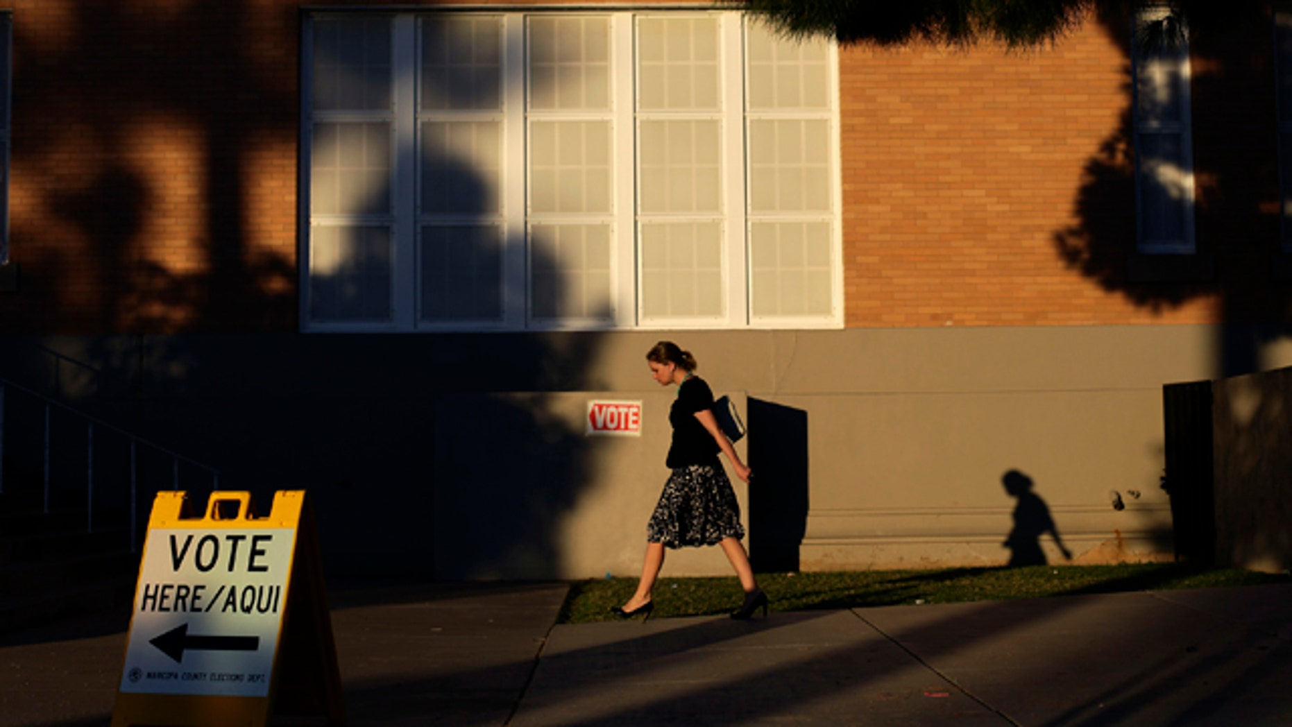 Nov. 6, 2012: A woman walks outside Kenilworth School as she prepares to vote during the U.S. presidential election in Phoenix, Arizona.