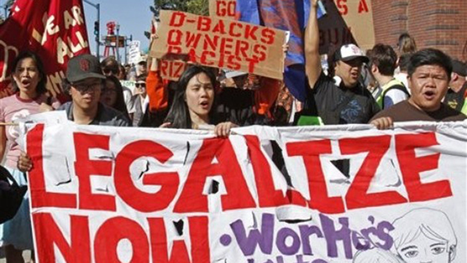 """Protestors outside AT&T Park join in the """"National Day of Action Against SB1070"""" by picketing the Arizona Diamondbacks vs. San Francisco Giants baseball game Saturday, May 29, 2010, in San Francisco. The protest was held in support of the Boycott Arizona campaign.(AP)"""
