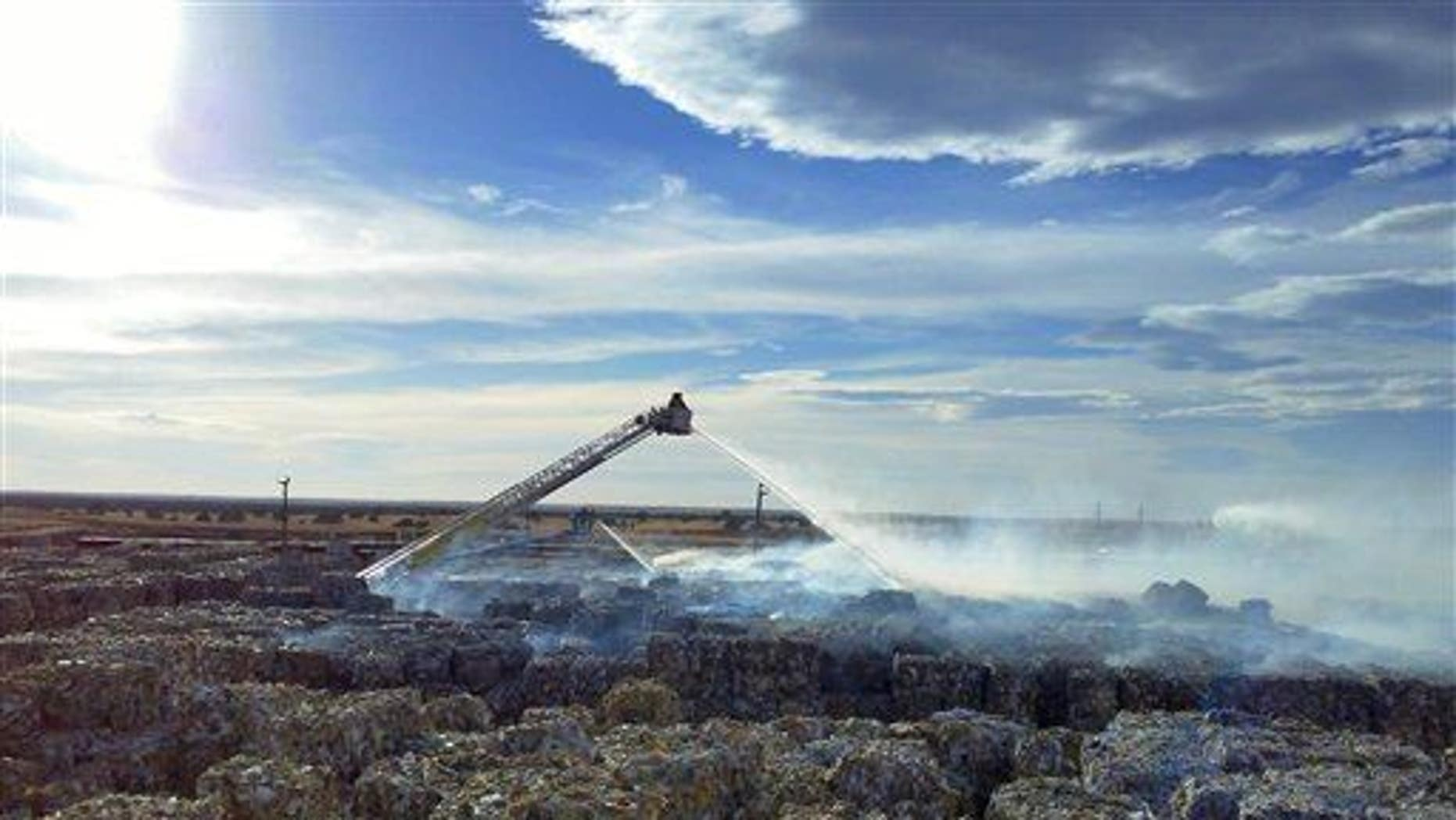 Firefighters in Snowflake, Arizona, douse a recycling fire in this file photo.