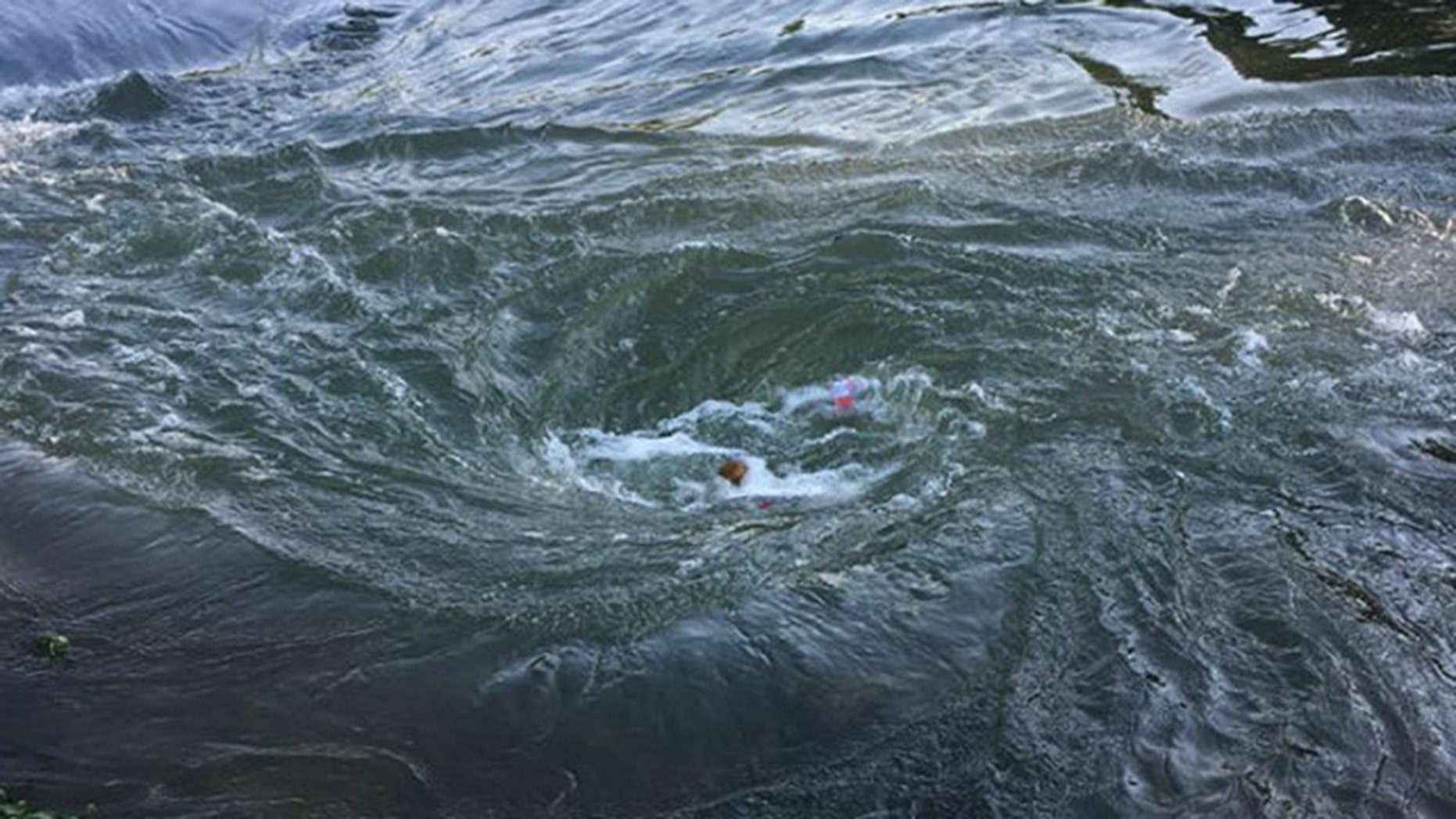 At least one boater died Saturday after a sinkhole opened on the bed of Spring River in northern Arkansas, creating a whirlpool, according to the Arkansas Game and Fish Commission. (Arkansas Game and Fish Commission)