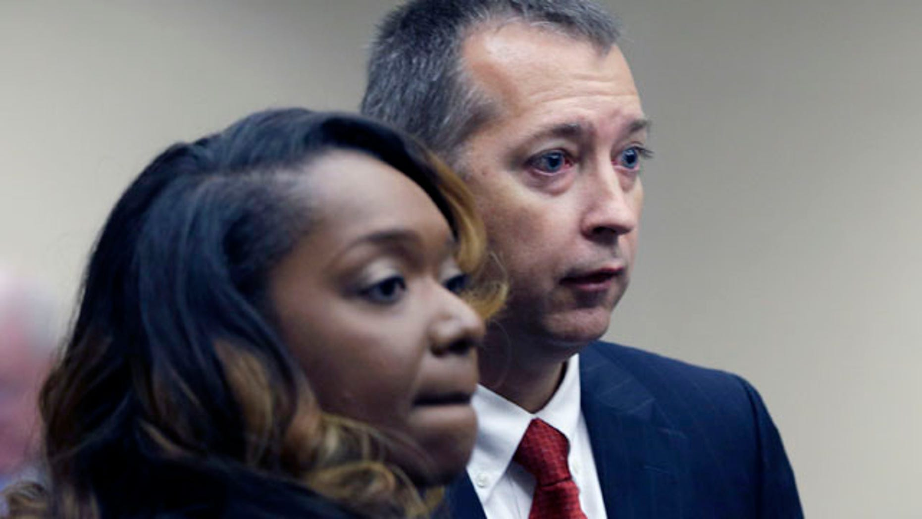 Aug. 14, 2013: Senior Assistant Arkansas Attorney General Warren Readnour, right, and Assistant AG Ka Tina Hodge appear before a meeting of the Arkansas Board of Private Investigators and Private Security Agencies in Little Rock, Ark.