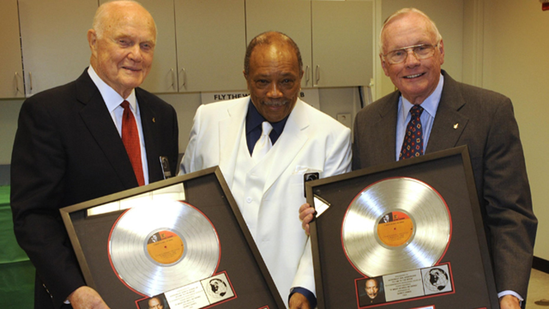 """Grammy Award-winning producer Quincy Jones (center) presented a platinum copy of """"Fly Me to the Moon"""" to Senator John Glenn (left) and Apollo 11 Commander Neil Armstrong (right) during NASA's 50th anniversary gala in 2008."""