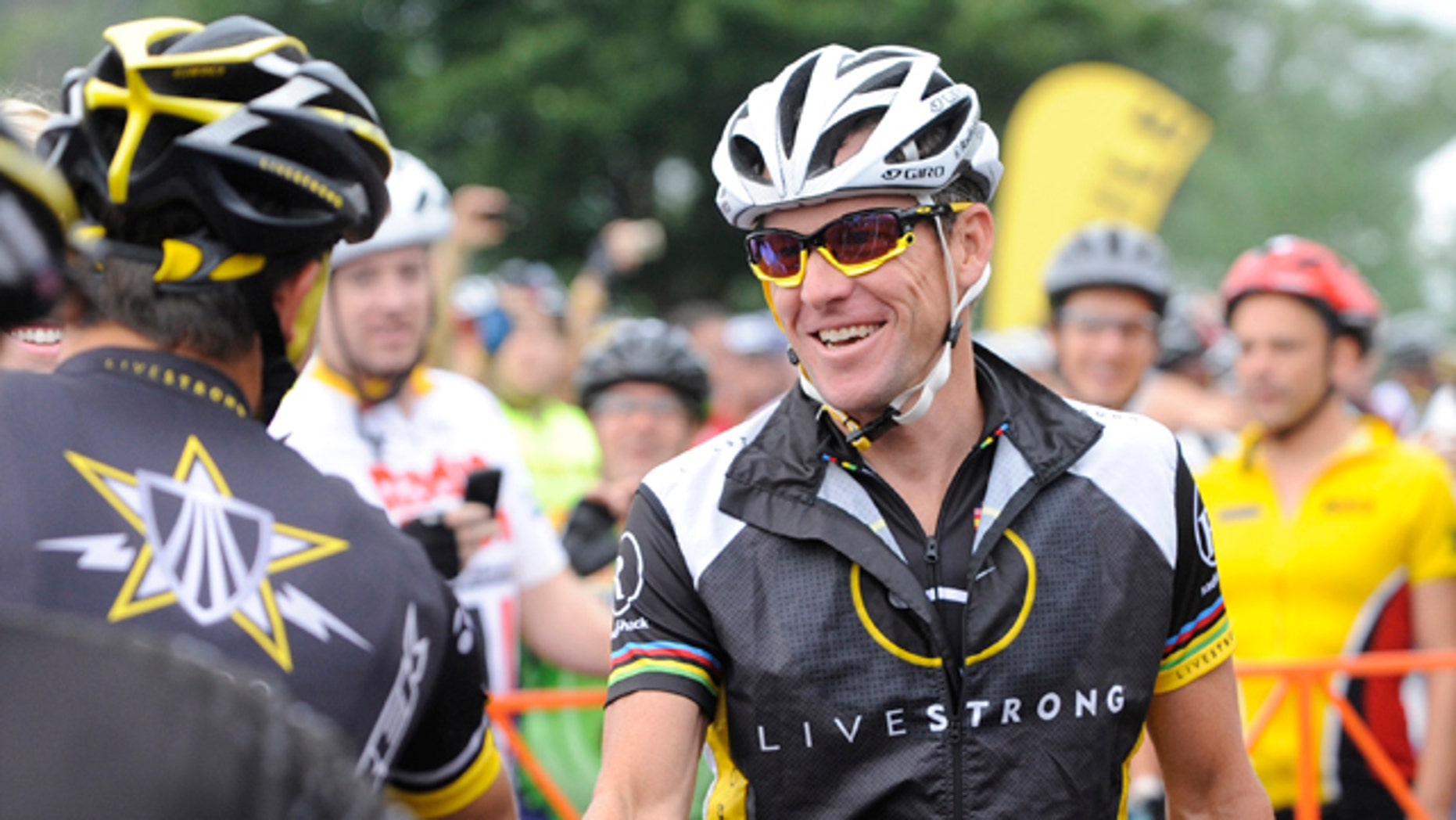Aug. 22, 2010: This file photo shows Lance Armstrong, center, greeting fellow riders prior to the start of his Livestrong Challenge 10K ride for cancer in Blue Bell, Pa.