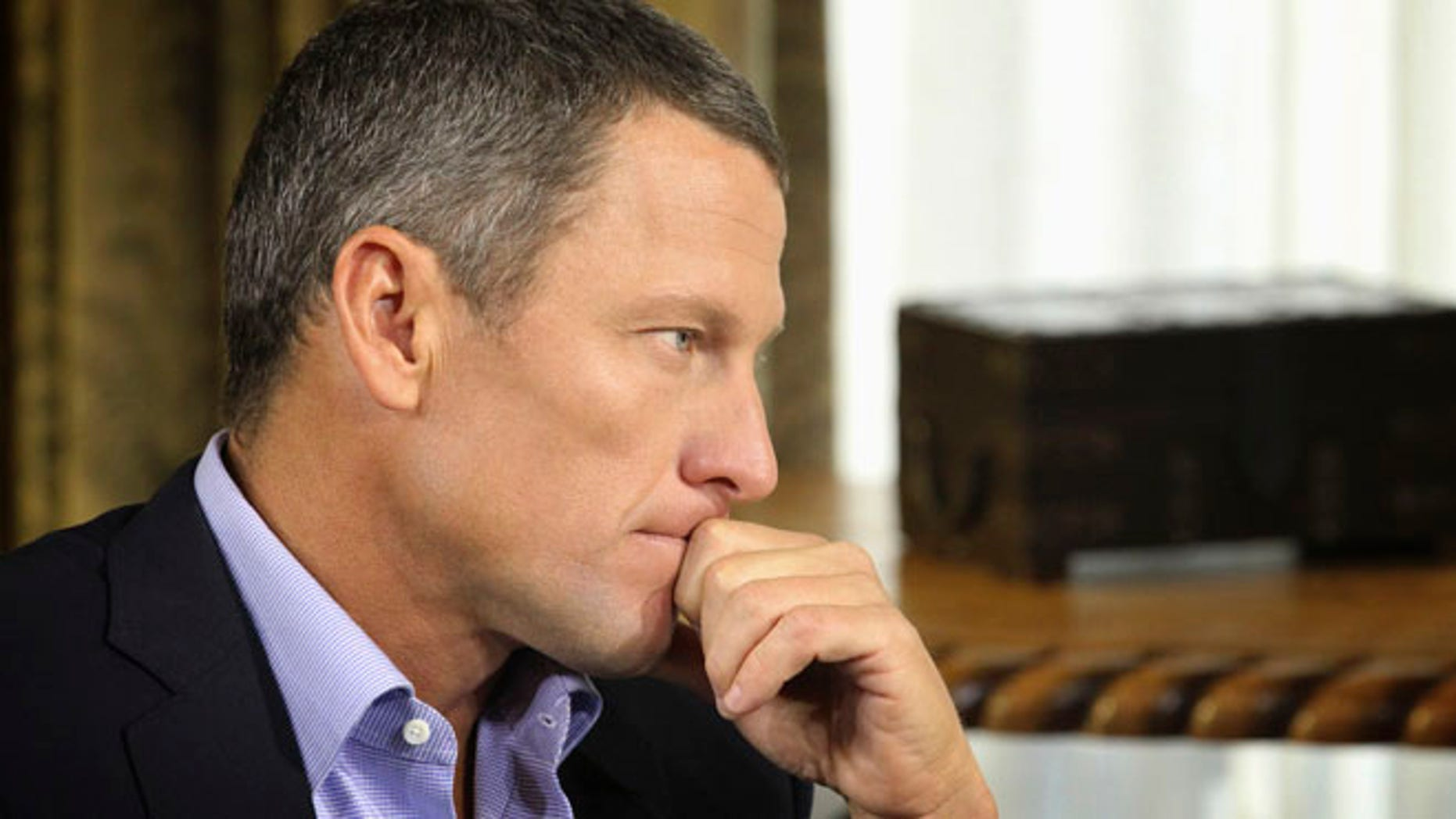 "Jan. 14, 2013: In this file photo provided by Harpo Studios Inc., Lance Armstrong listens as he is interviewed by talk show host Oprah Winfrey during taping for the show ""Oprah and Lance Armstrong: The Worldwide Exclusive"" in Austin, Texas."
