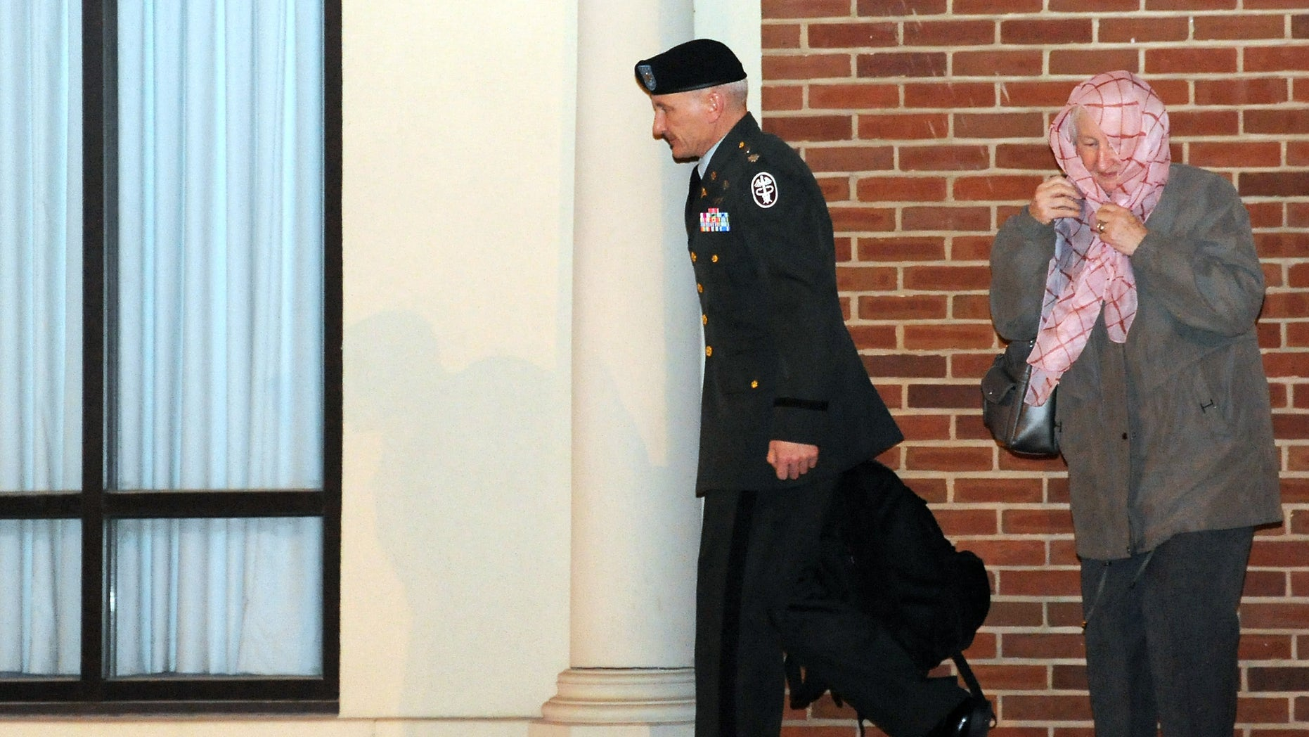 Dec. 15:Army Lt. Col. Terrence Lakin, left, of Greeley, Colo., leaves a military court after being found guilty of missing a flight for deployment at Fort Meade, Md.