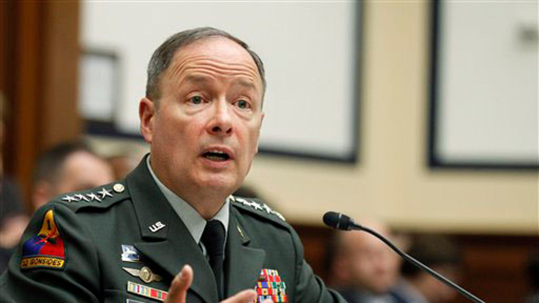Army Gen. Keith B. Alexander, commander of the U.S. Cyber Command, testifies on Capitol Hill in Washington, Thursday, Sept. 23, 2010, before the House Armed Services Committee hearing on cyberspace operations.