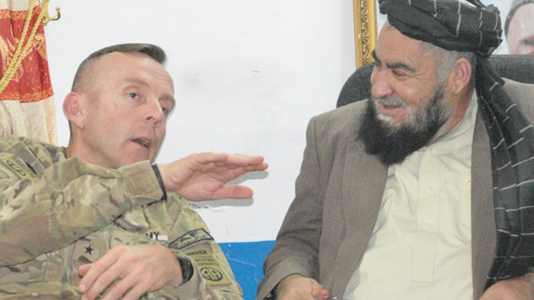 FILE 2011: Brigadier General Jeffrey Sinclair seen in Afghanistan talking with a local governor. Sinclair, once a rising star, is accused of sexually assaulting a captain under his command with whom he had a three-year affair.