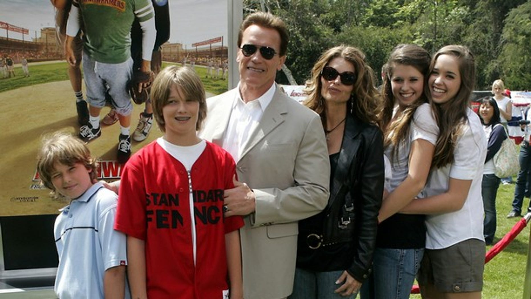 2006: Arnold Schwarzenegger (3rd L), wife Maria Shriver (3rd R), and children Christopher (L), Patrick (2nd L), Katherine and Christina (R) (Reuters)