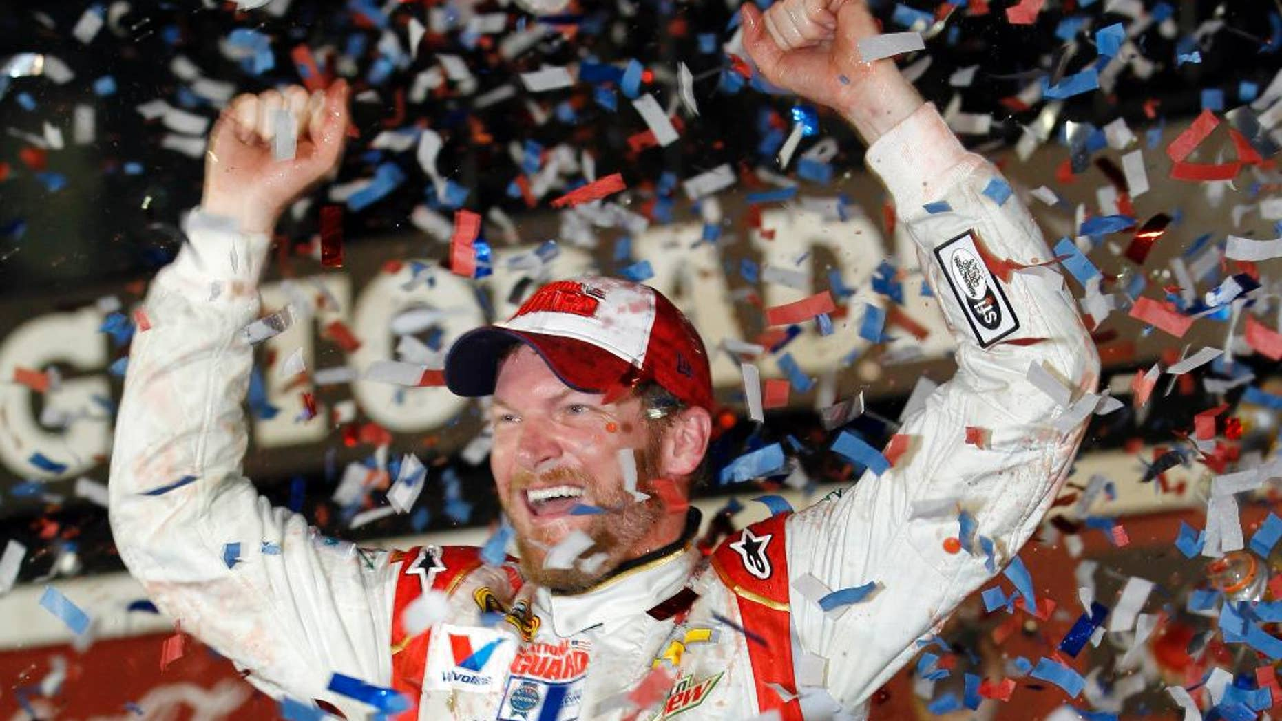 FILE - In this Feb. 23, 2014 file photo, Dale Earnhardt Jr. celebrates in Victory Lane after winning the NASCAR Daytona 500 Sprint Cup series auto race at Daytona International Speedway in Daytona Beach, Fla. As NASCAR heads West for a two-race swing through Phoenix and Las Vegas, the challenge becomes duplicating the Daytona 500 so that the remaining 36 events are half as exciting. (AP Photo/Terry Renna, File)