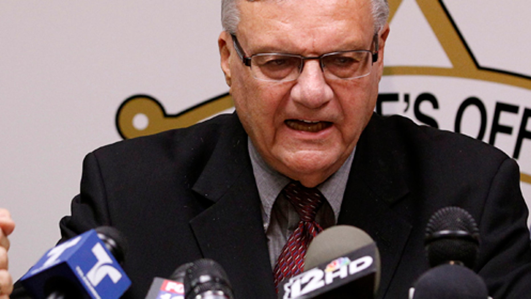 May 10, 2012: Maricopa County Sheriff Joe Arpaio, pounds his fist on the podium as he answers questions.