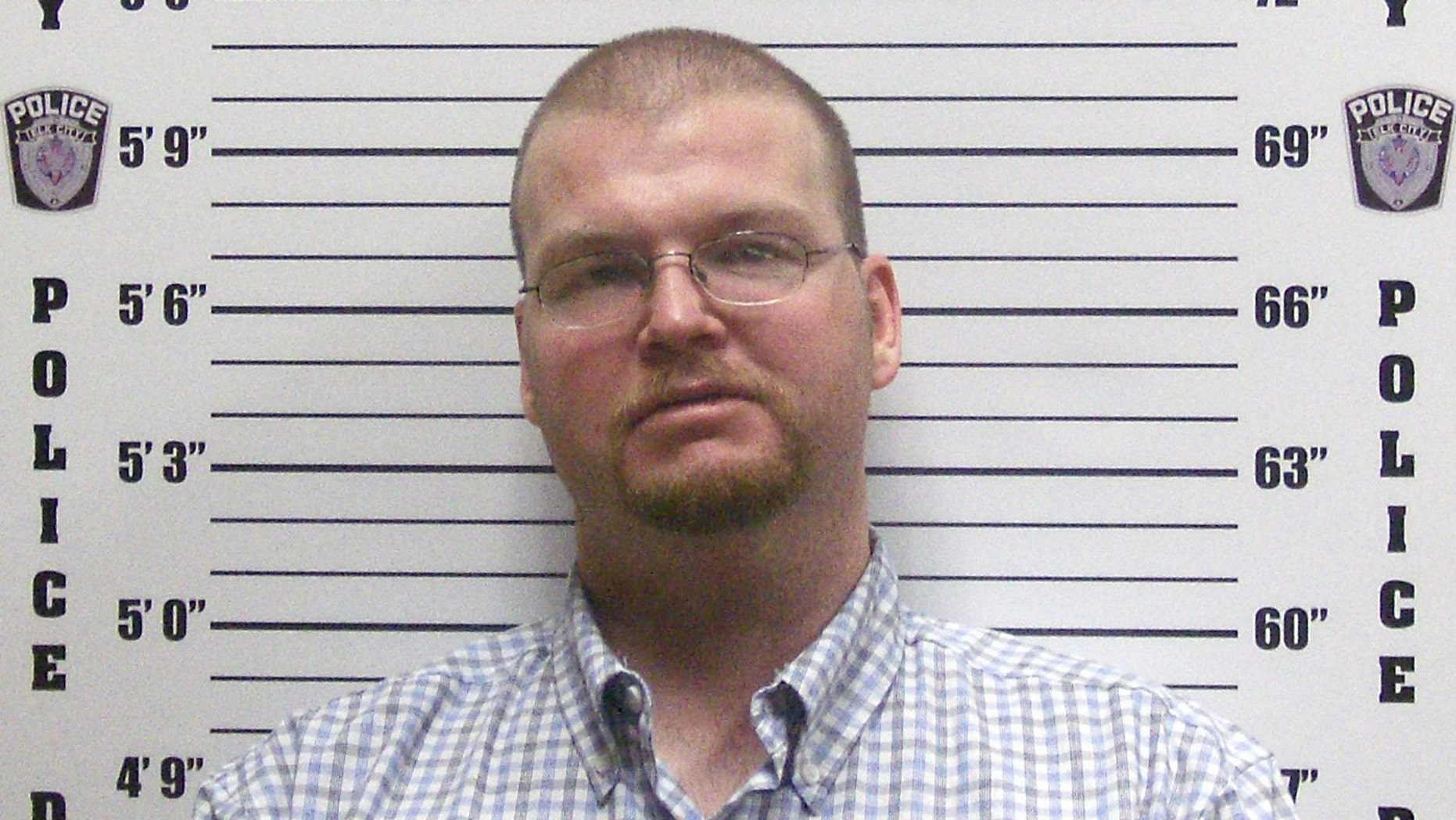 Justin Harrel in booking photo released by Elk City, Ok.
