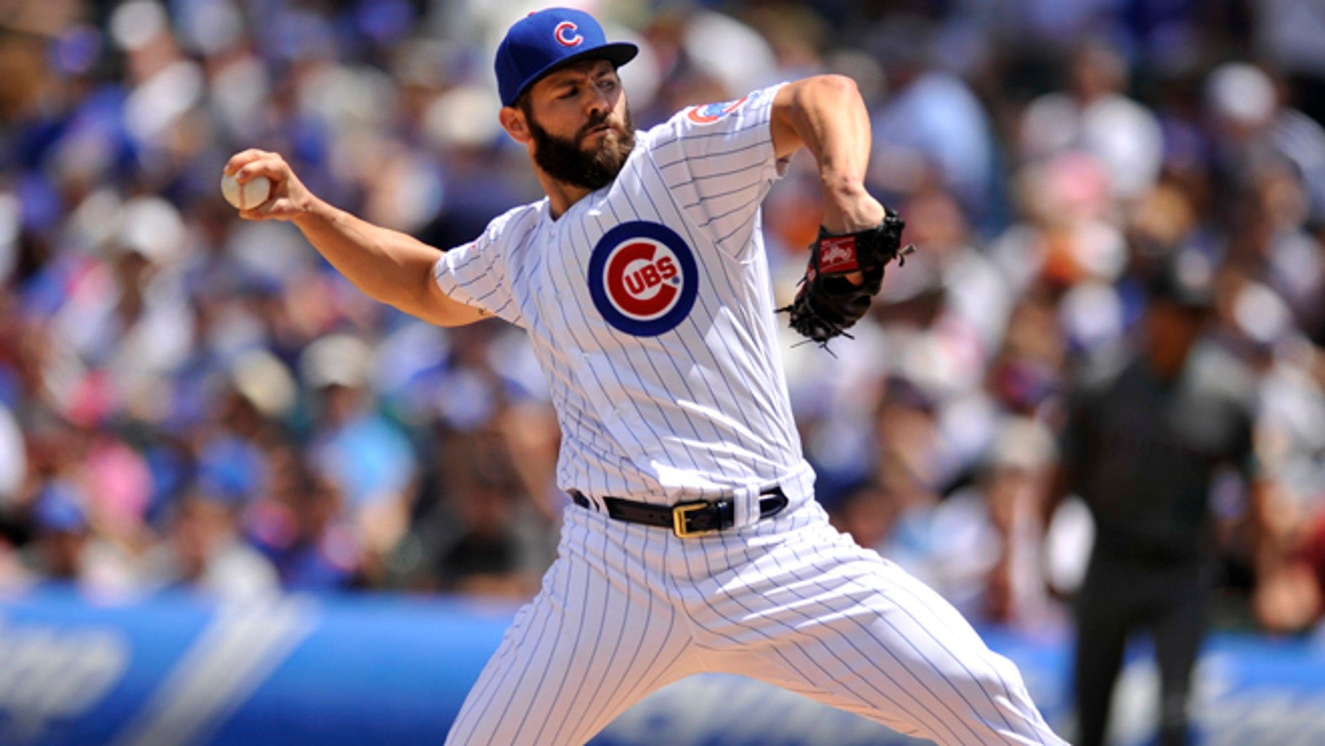 Chicago Cubs starter Jake Arrieta delivers a pitch during the first inning of a baseball game against the Arizona Diamondbacks, Sunday, June 5, 2016, in Chicago. (AP Photo/Paul Beaty)