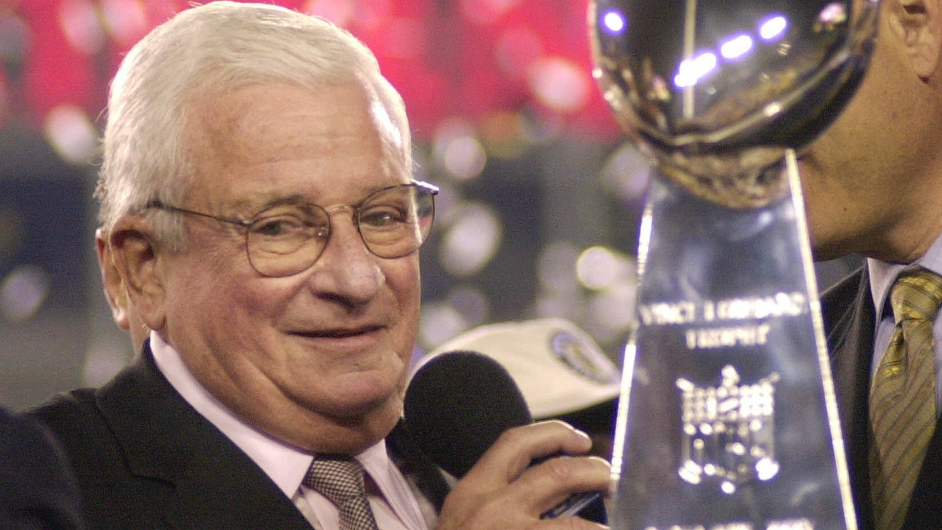 Baltimore Ravens owner Art Modell is seen with the Vince Lombardi Trophy after the Ravens beat the New York Giants 34-7 in Super Bowl XXXV.