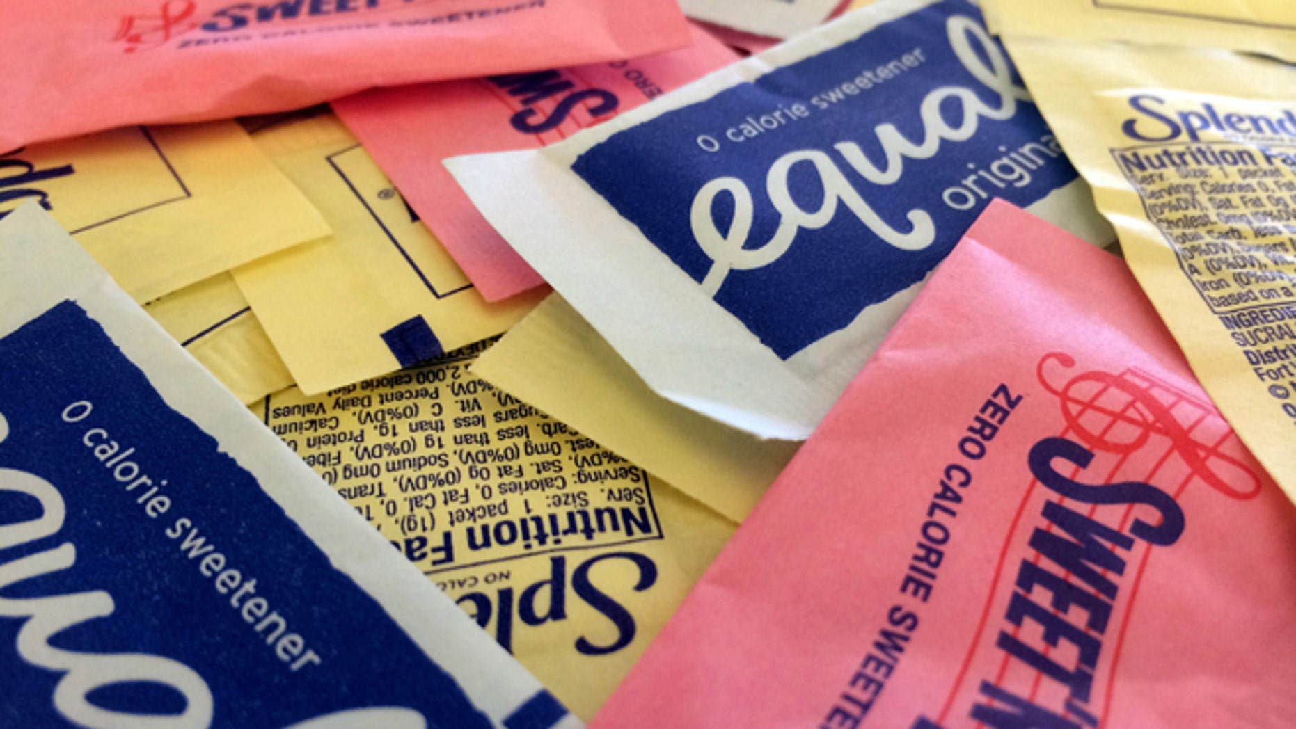 Artificial sweeteners are displayed, on Wednesday, Sept. 17, 2014, in New York. Artificial sweeteners may set the stage for diabetes in some people by hampering the way their bodies handle sugar, according to results of a study released Wednesday by the journal Nature. (AP Photo/Jenny Kane)