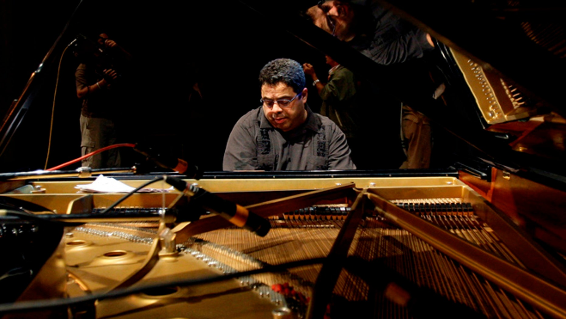 """FILE - In this Dec. 15, 2011 file photo, U.S. pianist and composer Arturo O'Farrill rehearses for Cuba's 27th International Jazz Festival in Havana, Cuba. O'Farrill is nominated for two Grammys, one for large jazz ensemble album for """"Cuba:The Conversation Continues,"""" and best instrumental composition for """"The Afro Latin Jazz Suite."""" (AP Photo/Franklin Reyes, File)"""