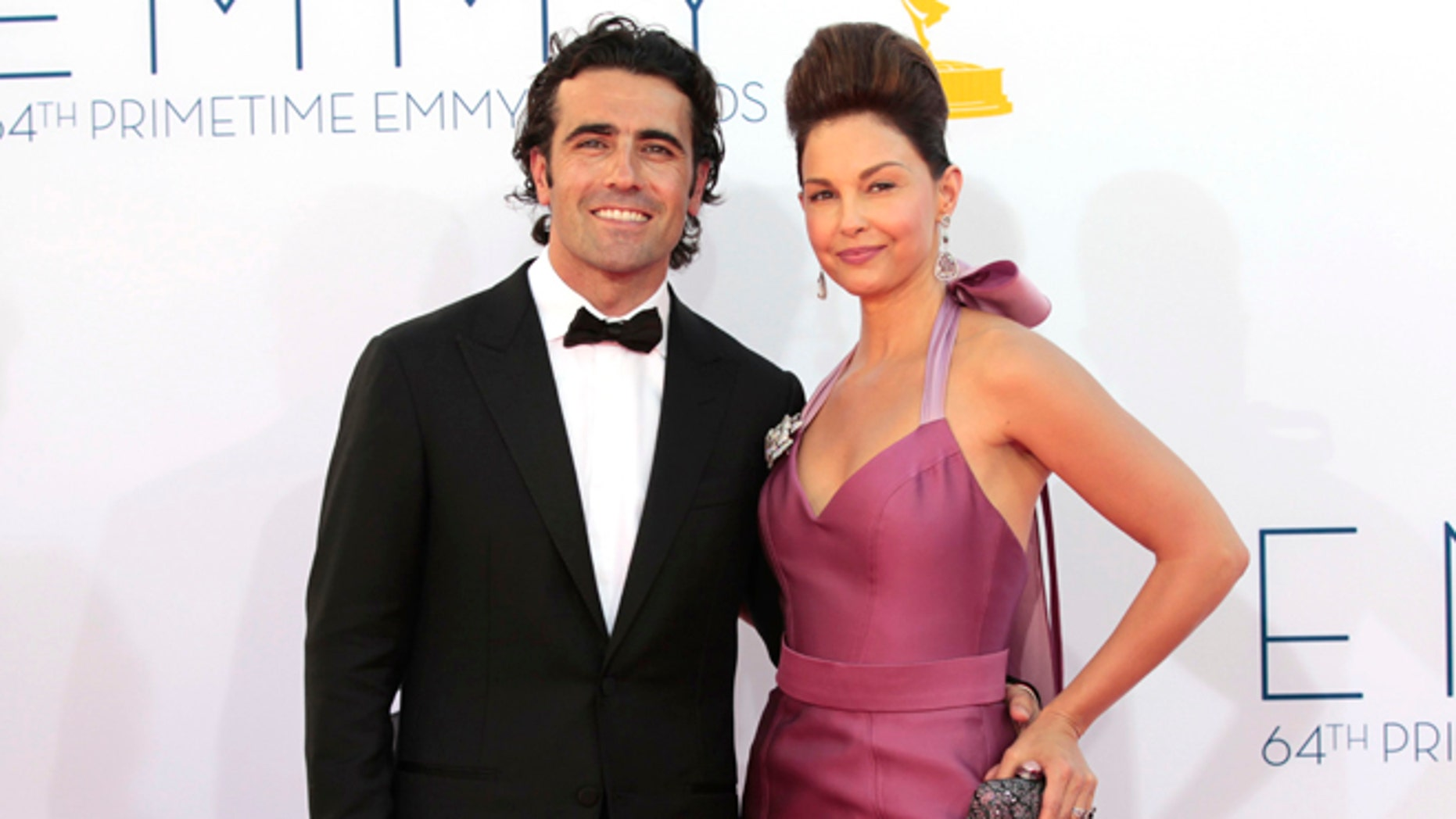 Ashley Judd and Scottish racecar driver Dario Franchitti arrive at the 64th Primetime Emmy Awards in Los Angeles September 23, 2012.