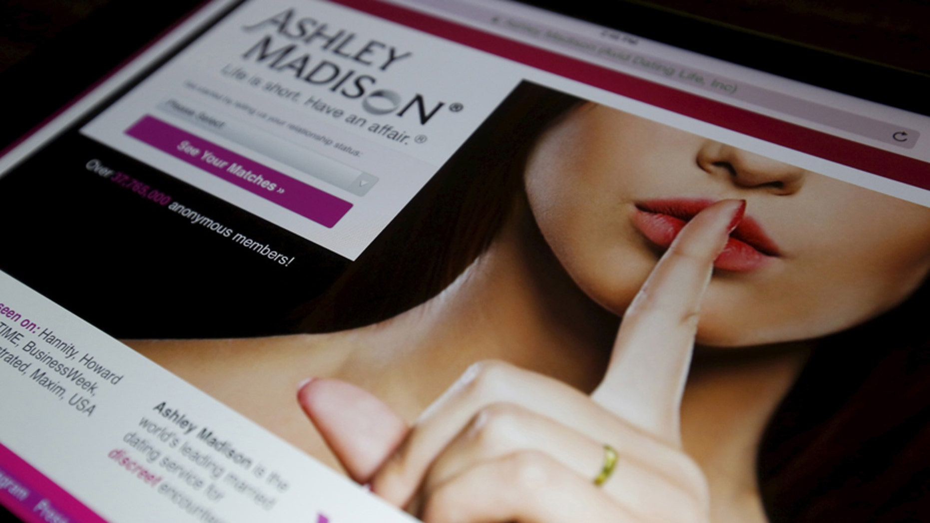 The homepage of the Ashley Madison website is displayed on an iPad, in this photo illustration taken in Ottawa, Canada July 21, 2015.