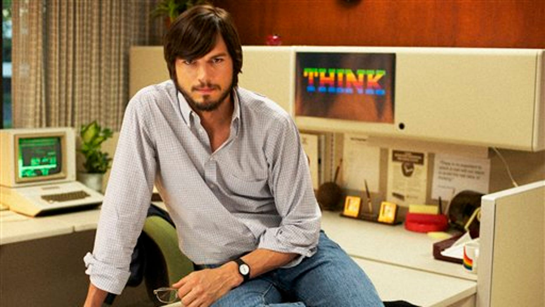 "This undated publicity photo released by the Sundance Institute shows Ashton Kutcher as Steve Jobs in the film, ""jOBS."""