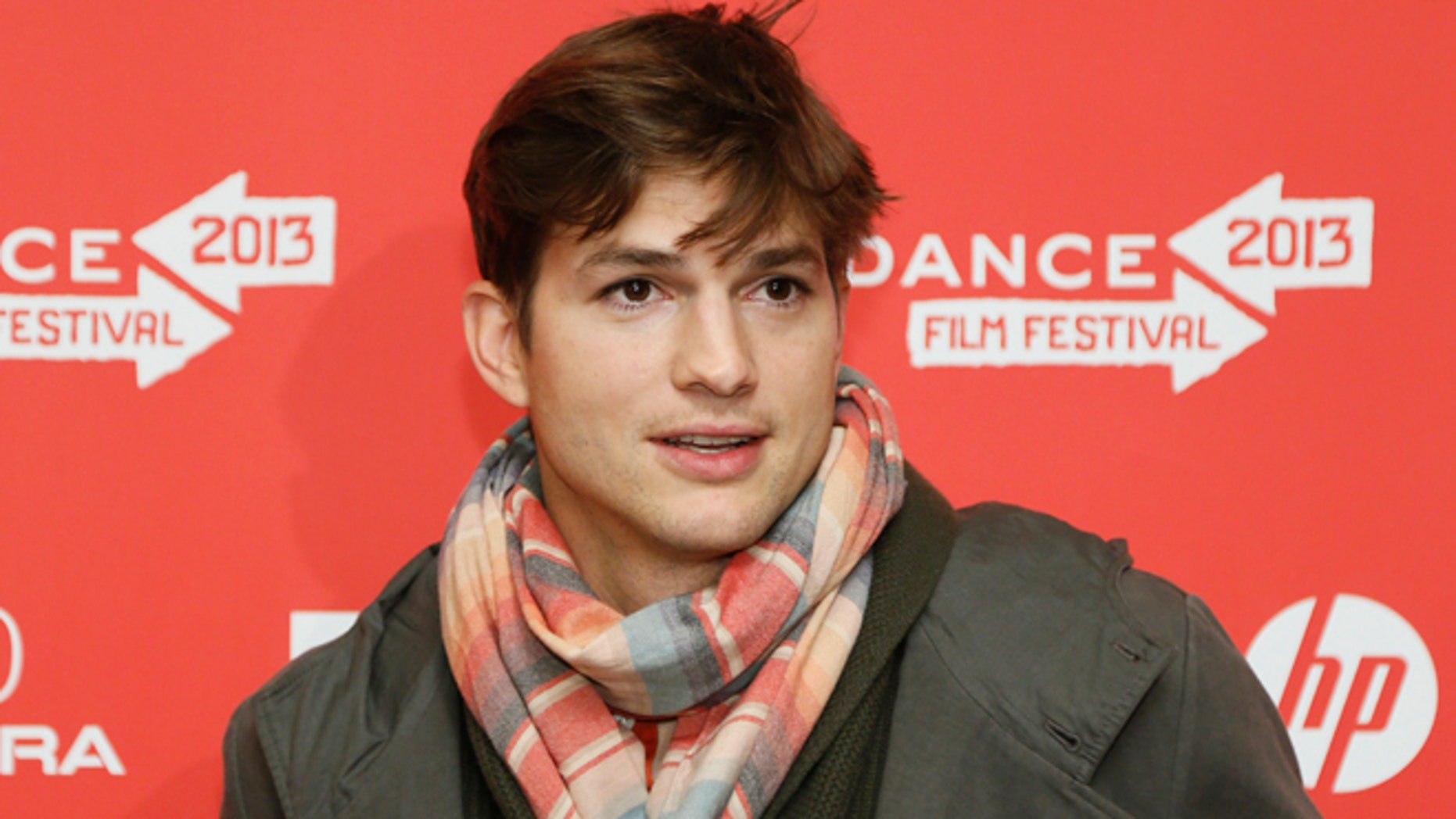 "Jan. 25, 2013: Actor Ashton Kutcher, who portrays Apple's Steve Jobs in the film ""jOBS,"" poses at its premiere during the 2013 Sundance Film Festival in Park City, Utah."