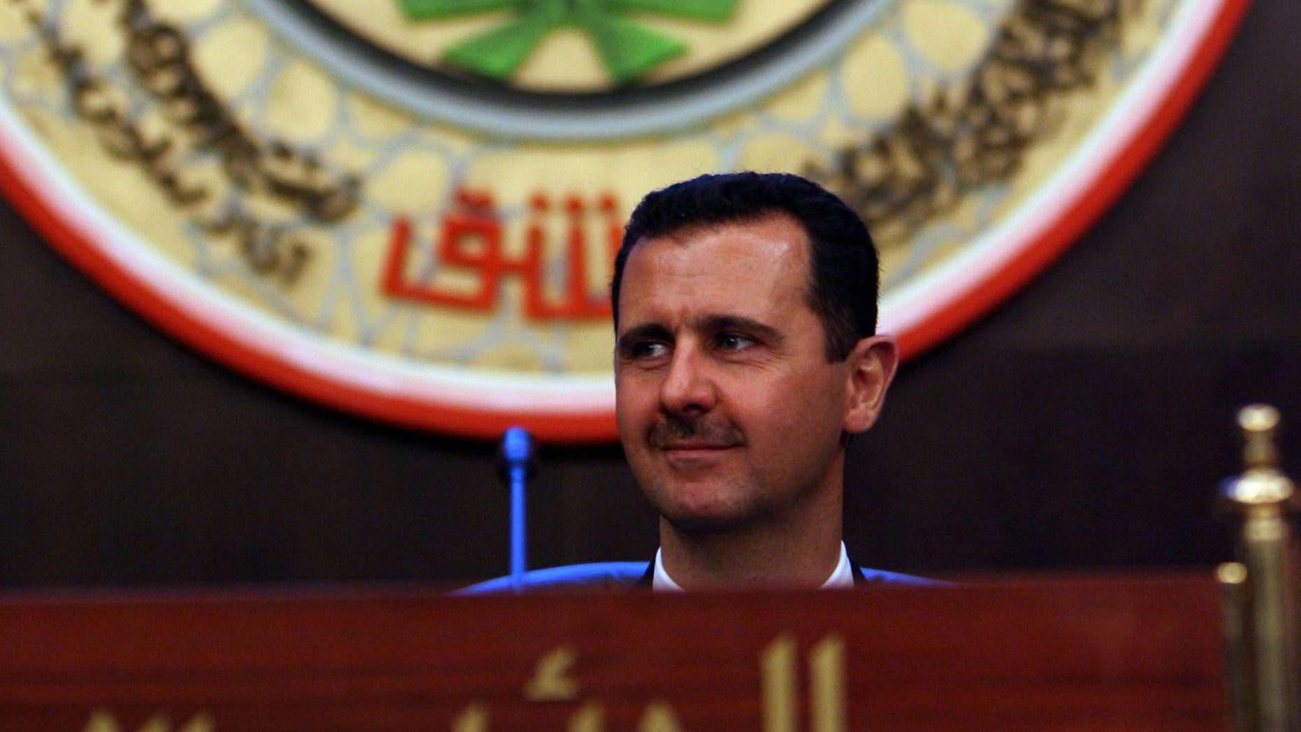 Syrian President Bashar al-Assad heads the closing of the two-day Arab summit on March 30, 2008 in Damascus, Syria. (Photo by Salah Malkawi/ Getty Images)