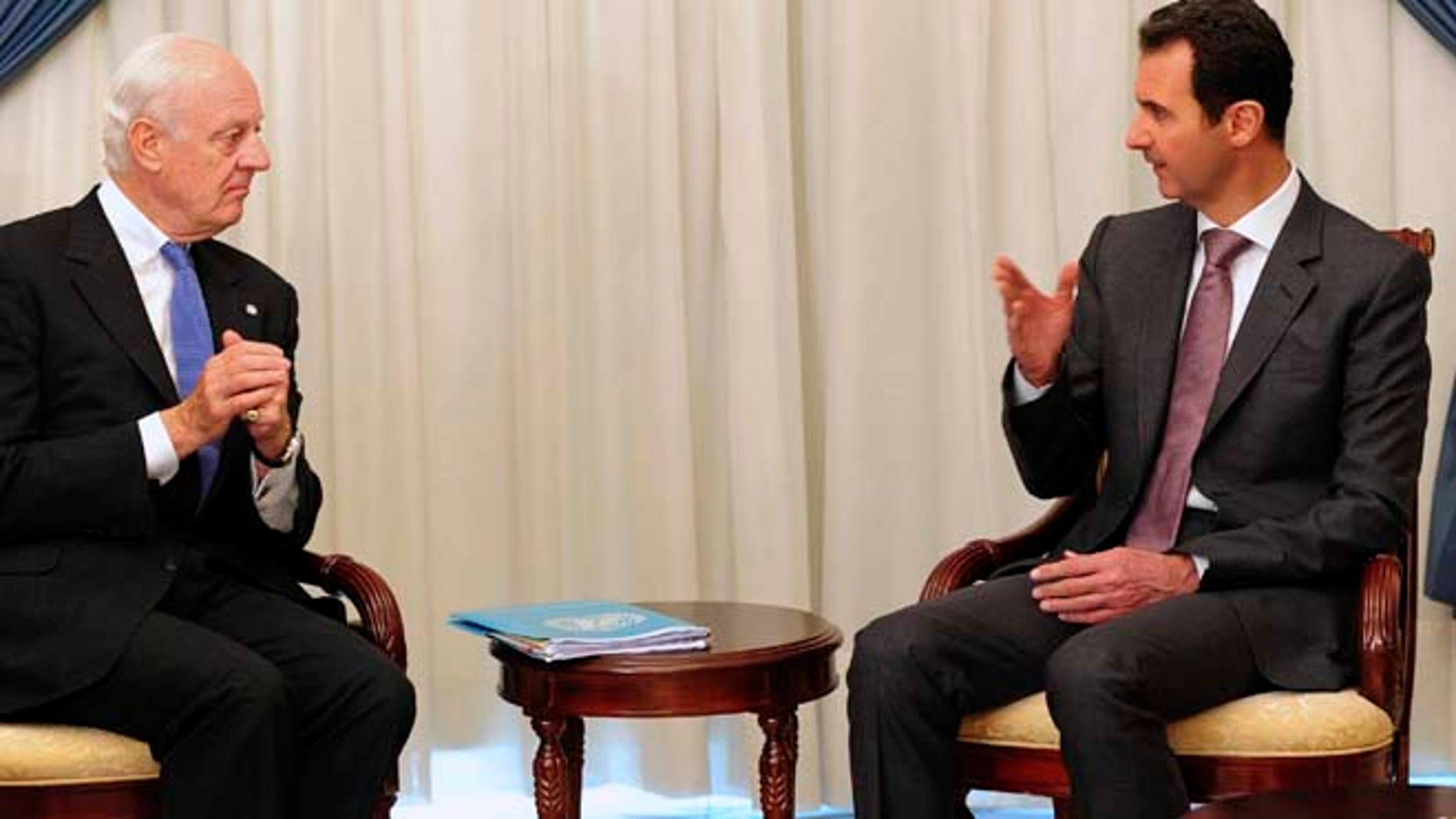 Nov. 10, 2014: In this photo released by the Syrian official news agency SANA, Syrian President Bashar Assad, right, speaks with United Nations special envoy to Syria Staffan de Mistura in Damascus, Syria. (AP/SANA)