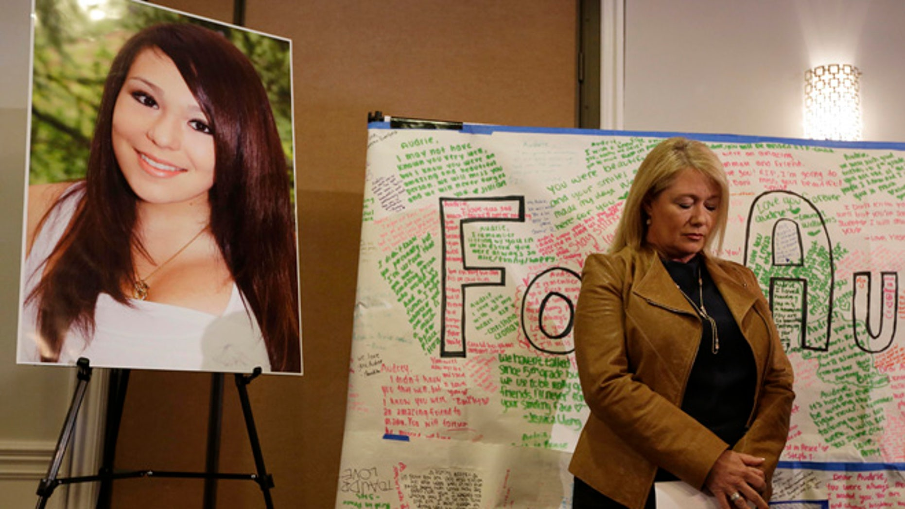 April 15: Sheila Pott, mother of Audrie Pott, stands by a photograph of her daughter and message board during a news conference in San Jose, Calif.