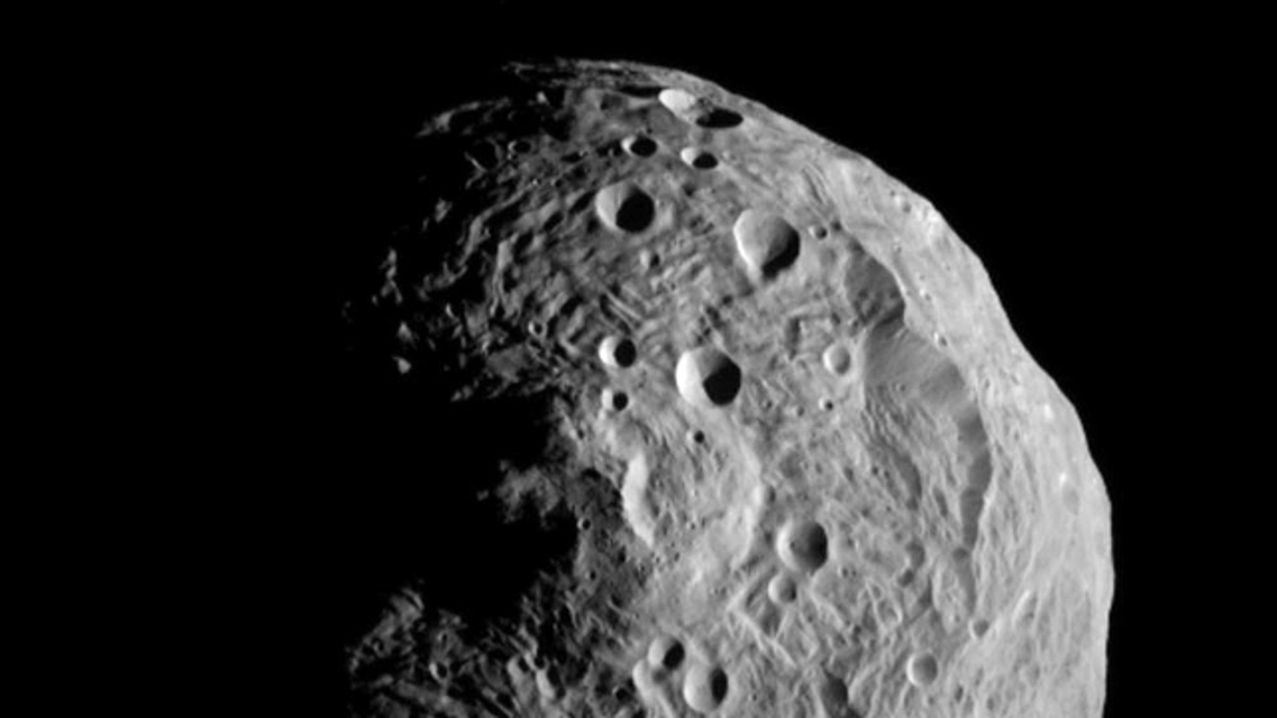 July 17, 2011: The asteroid Vesta, photographed by the Dawn spacecraft. The image was taken from a distance of about 9,500 miles (15,000 kilometers) away.