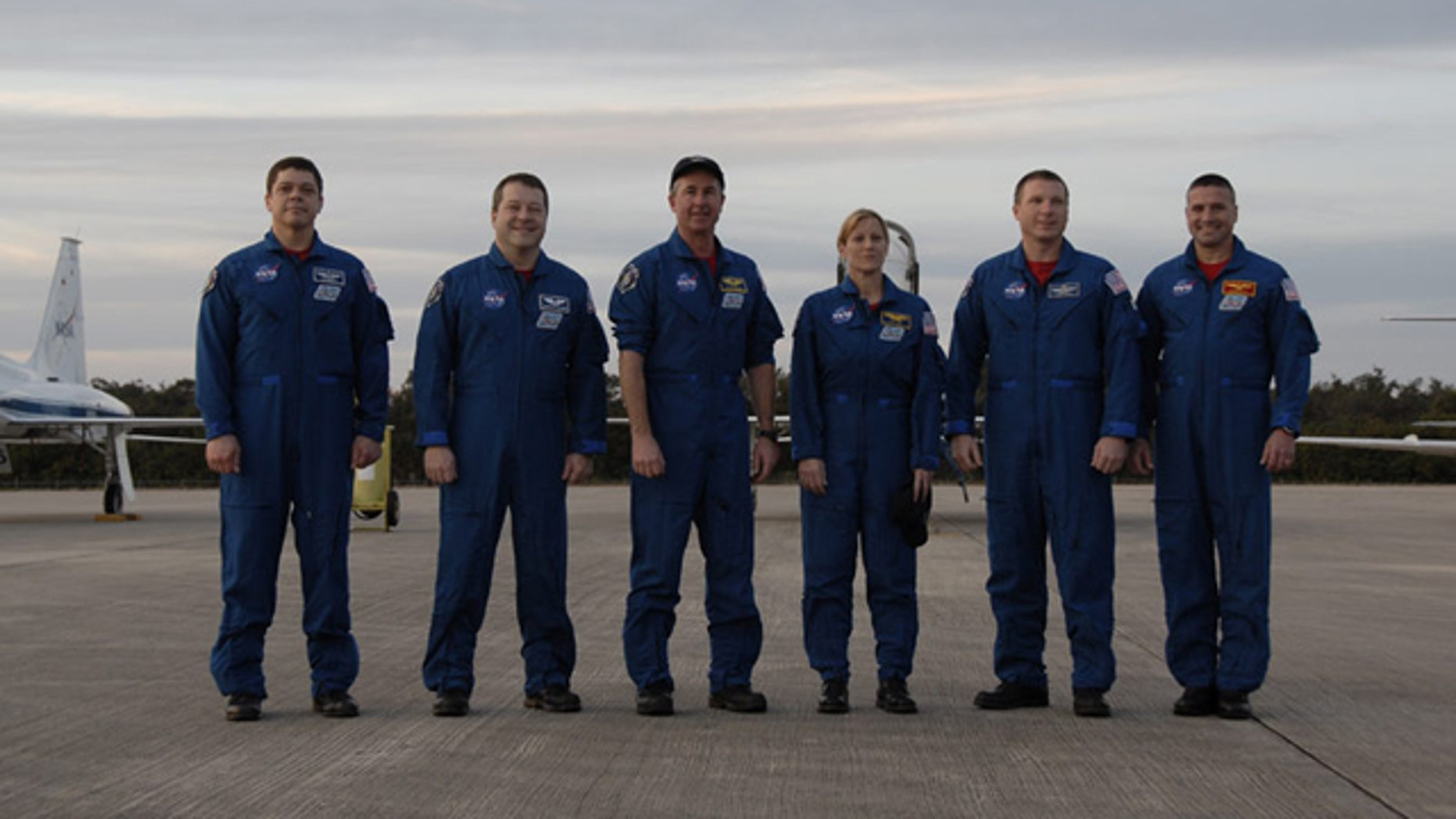 The six-astronaut crew of shuttle Endeavour's STS-130 mission pose for a photo at NASA's Shuttle Landing Facility after arriving Jan. 18, 2010 for prelaunch training. Liftoff is set for Feb. 7.