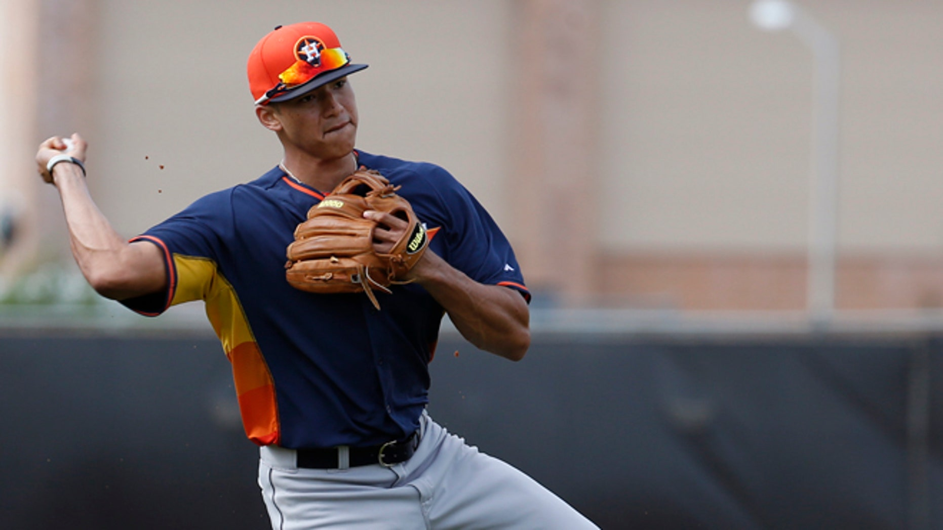 In this Feb. 21, 2014 file photo, Houston Astros' Carlos Correa throws the ball to first base during a spring training baseball workout in Kissimmee, Fla. Correa is one of the top prospects of the Astros, part of a group expected to turn around this once proud franchise and get fans back to the ballpark after three straight 100-loss seasons.  (AP Photo/Alex Brandon, File)