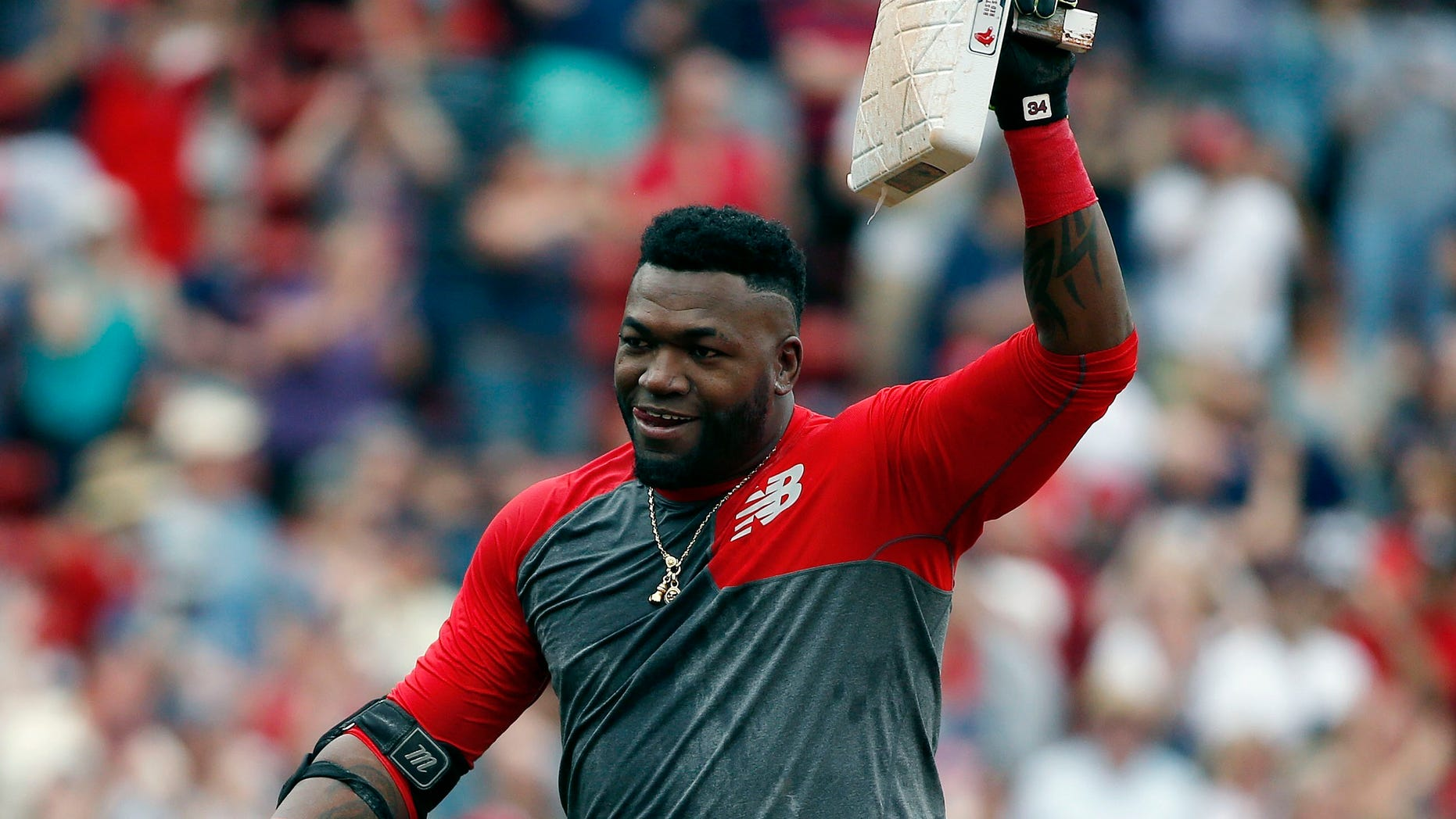 Boston Red Sox's David Ortiz holds up second base after hitting the game-winning RBI double during the 11th inning of a baseball game against the Houston Astros in Boston, Saturday, May 14, 2016. The Red Sox won 6-5. (AP Photo/Michael Dwyer)