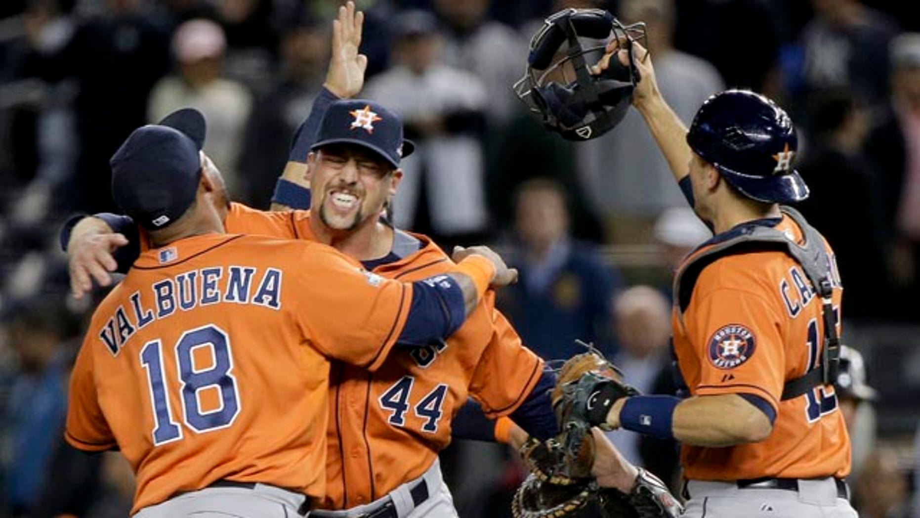 Oct. 6, 2015: Houston Astros' Luis Valbuena (18), Luke Gregerson (44) and Jason Castro, right, celebrate after the Astros defeated the New York Yankees 3-0 in the American League wild card baseball game in New York. (AP Photo/Julie Jacobson)