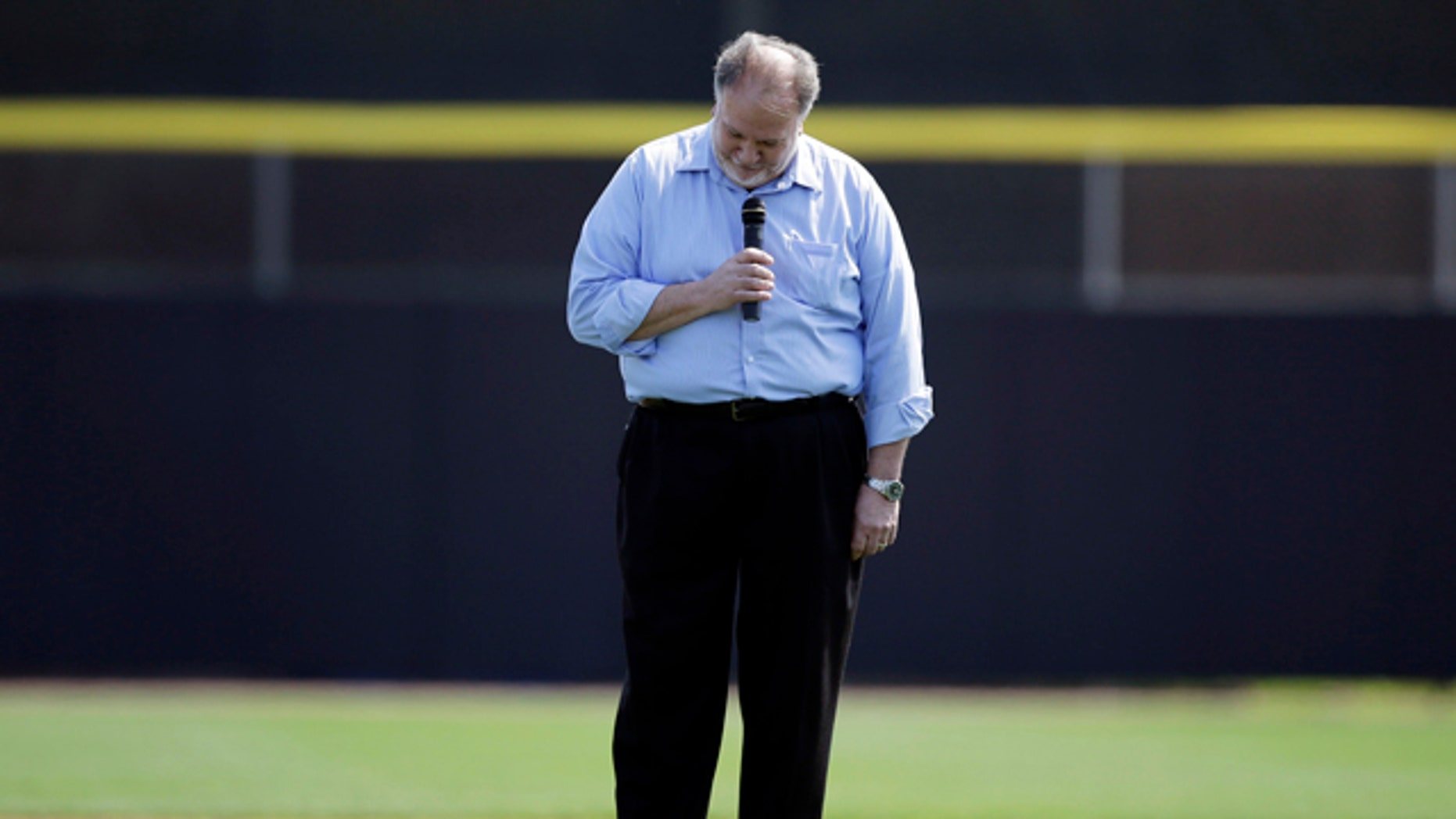 Feb. 27, 2013: Singer Jeff Fuller reacts after forgetting lyrics to the Canadian national anthem before an exhibition baseball game between the Toronto Blue Jays and the Houston Astros.