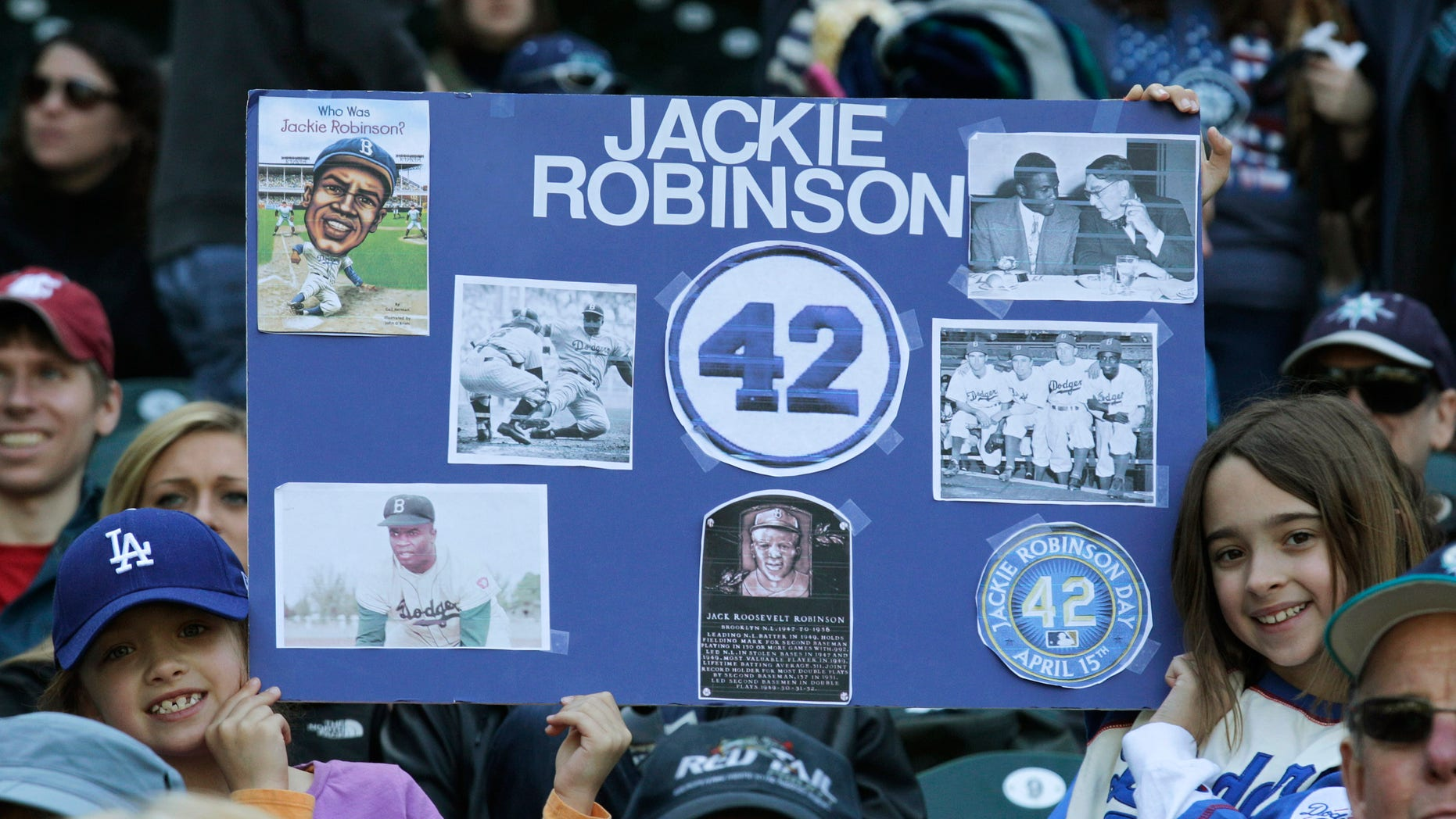 April 15: Young fans pay tribute to Jackie Robinson prior to a MLB baseball game between the Seattle Mariners and the Oakland Athletics in Seattle.