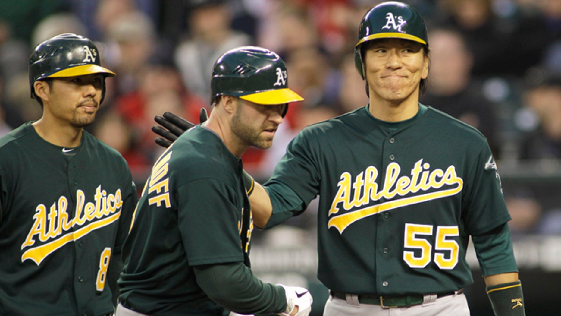 April 23, 2011: Oakland Athletics' Kevin Kouzmanoff, center, is greeted by Hideki Matsui, right, after Matsui and Kurt Suzuki, left, scored when Kouzmanoff hit a three-run home run against the Seattle Mariners in the sixth inning of a baseball game.