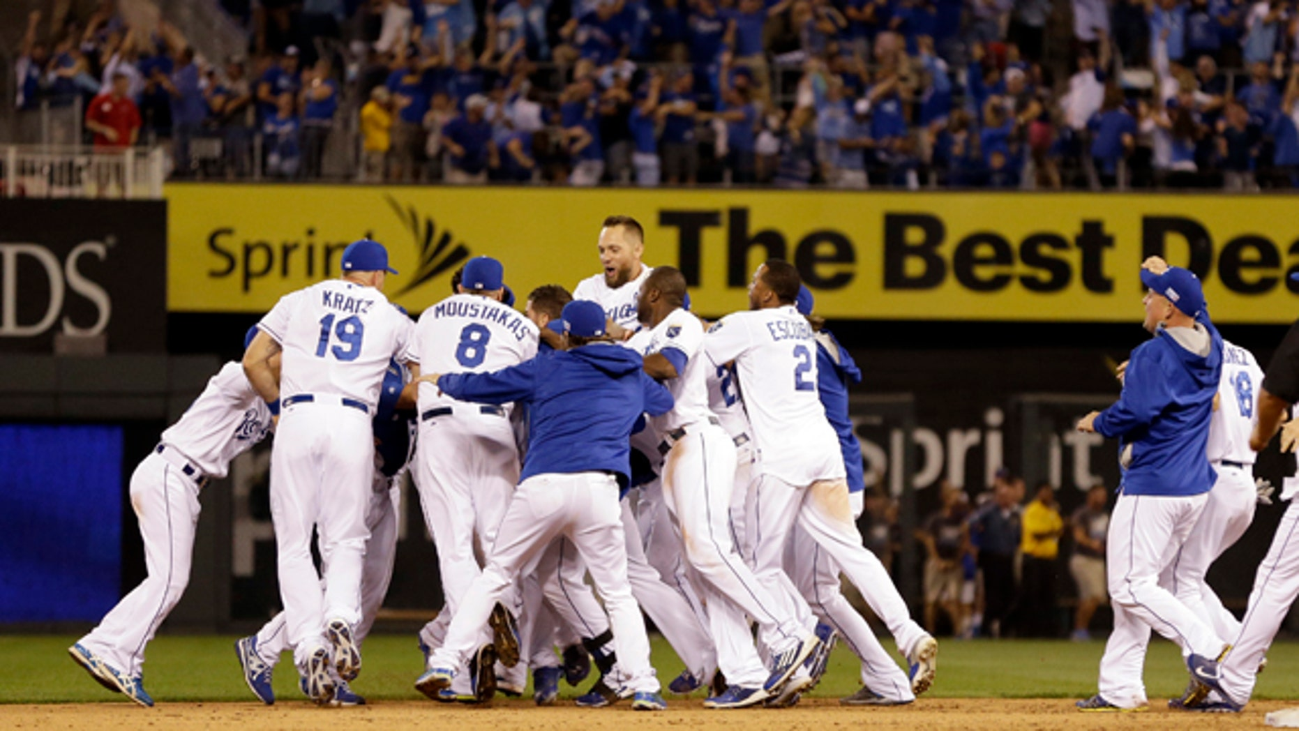 September 30, 2014: Kansas City Royals mob teammate Salvador Perez after he hit a walk-off single in the 12th inning to defeat the Oakland Athletics 9-8 in the AL wild-card playoff baseball game in Kansas City, Mo. (AP Photo/Jeff Roberson)
