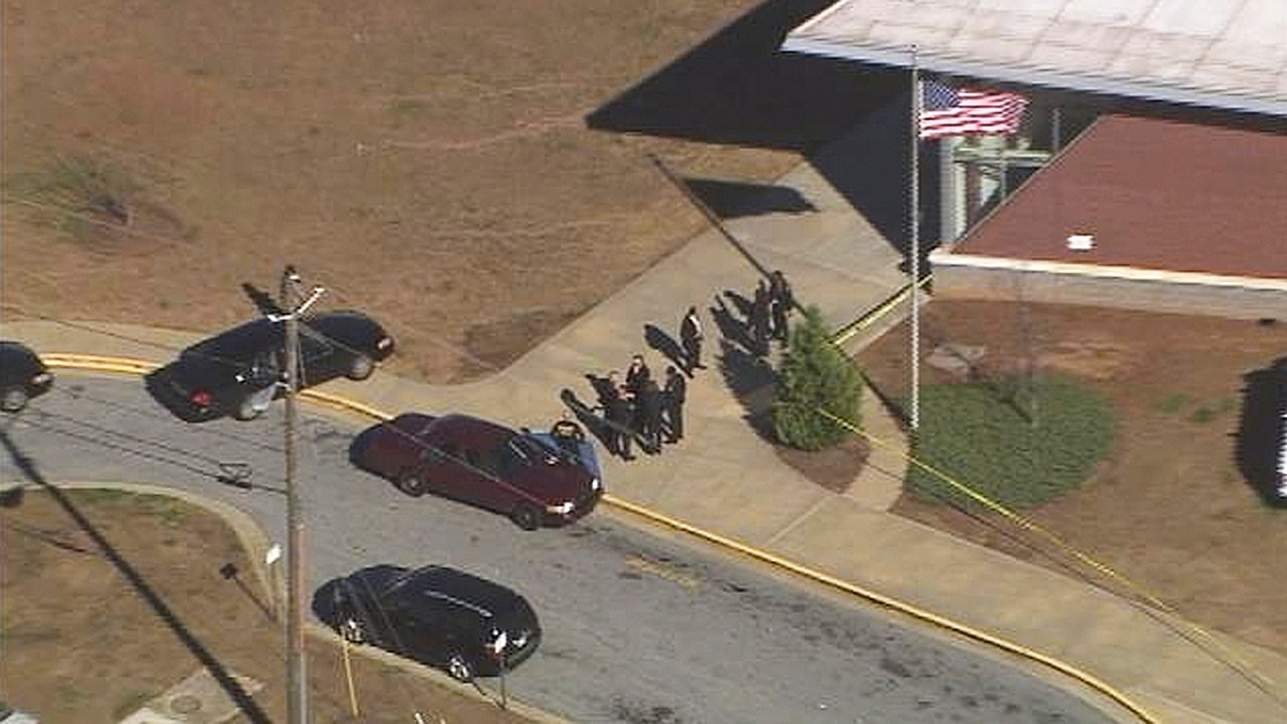 Jan. 31, 2013: In this image made from video and released by WSB-TV, authorities investigate the scene of a school shooting in Atlanta.