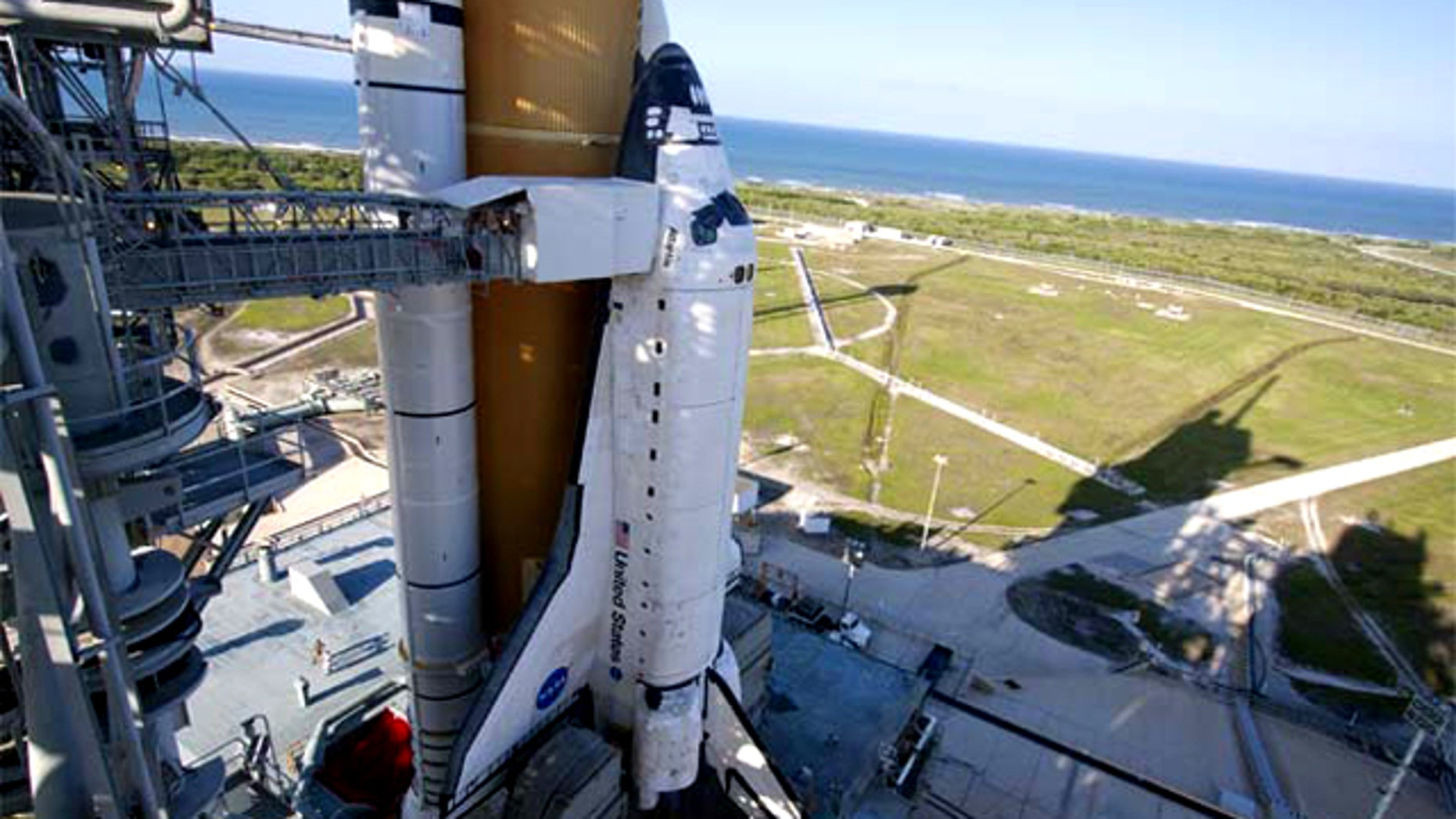 At NASA Kennedy Space Center's Launch Pad 39A, space shuttle Atlantis is revealed Thursday evening after retraction of the pad's rotating service structure. The shuttle is scheduled to lift off Friday at 2:20 p.m. EDT.