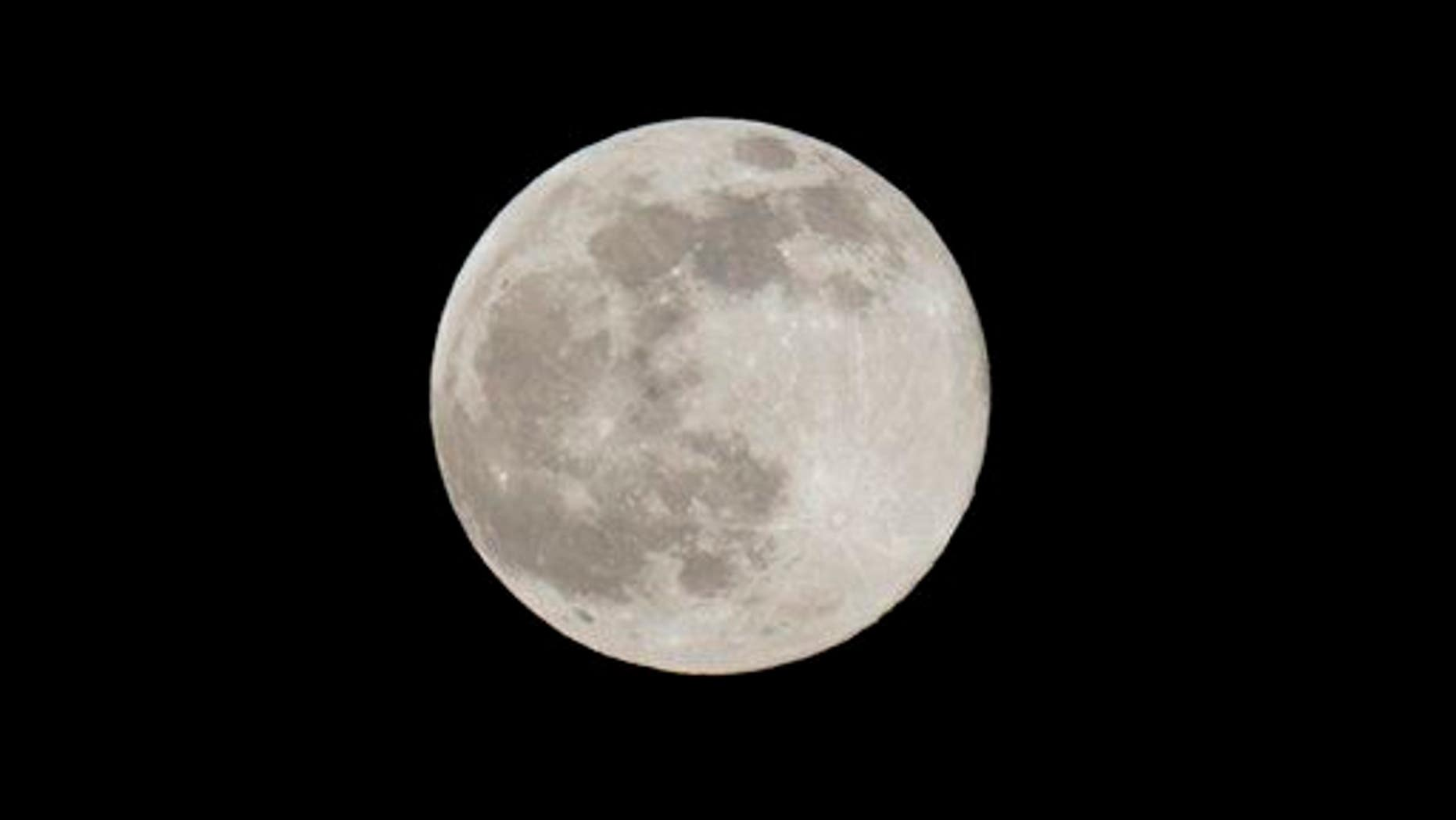 A Blue Moon rises Friday, July 31, 2015 as seen from Taguig city east of Manila, Philippines.